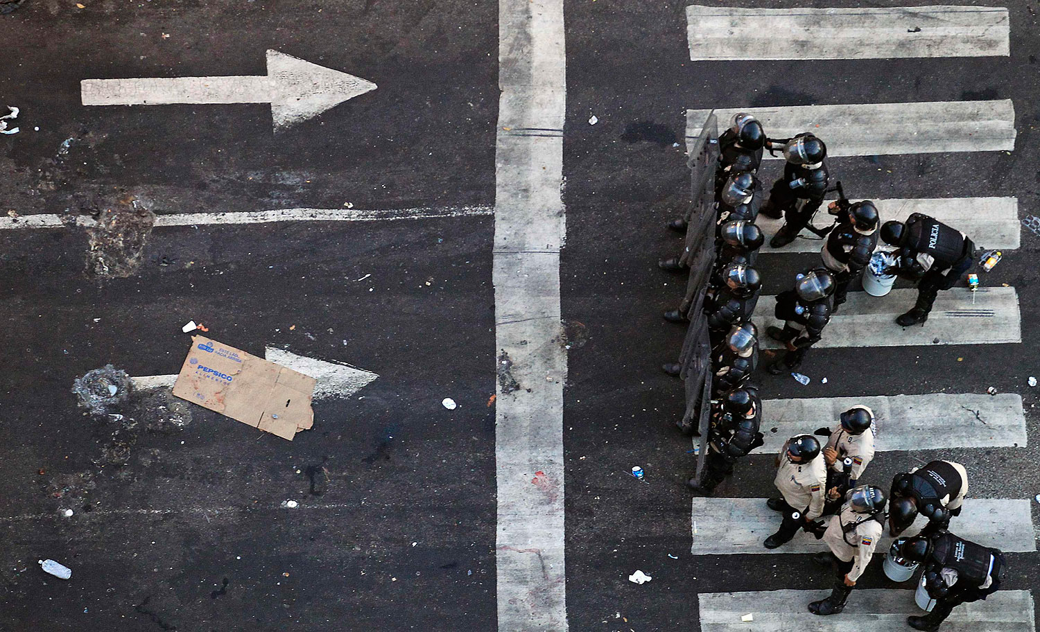 Riot police advance towards demonstrators during a protest against the government of President Nicolas Maduro in Caracas, Feb. 22, 2014.