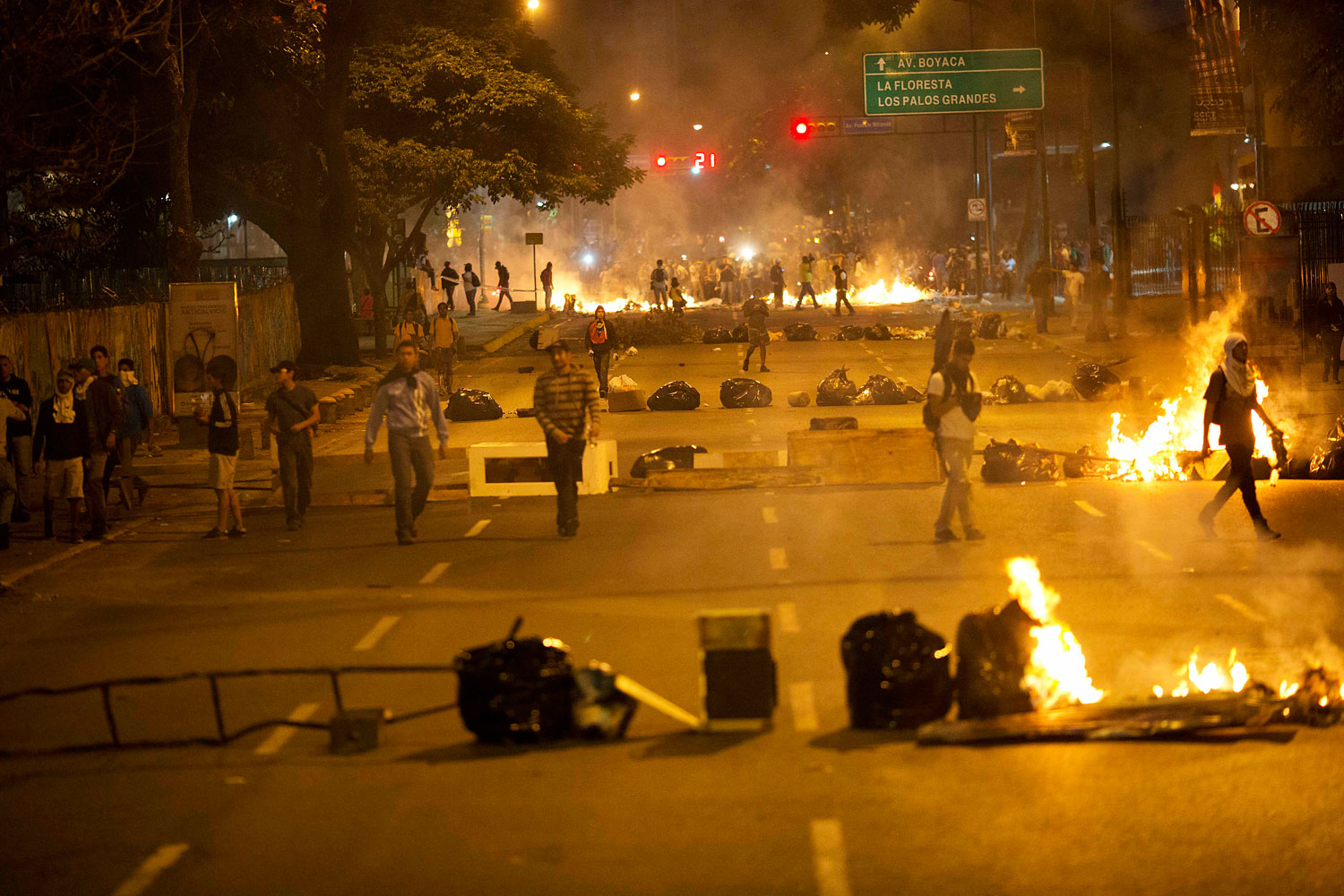 Objects placed by opposition protesters block a road in the Altamira neighborhood of Caracas, Feb. 20, 2014.