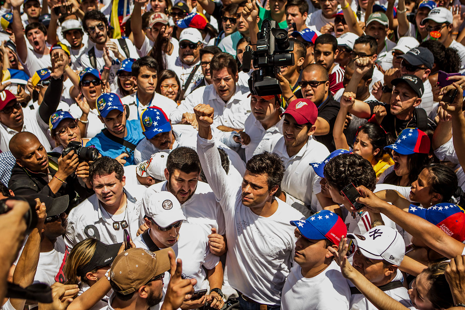 Opposition leader Leopoldo López arrives to the march in a swarm of supporters, Feb. 18, 2014.  Thousands of people took to the streets today to support López as he surrendered to police during a peaceful march in Caracas.