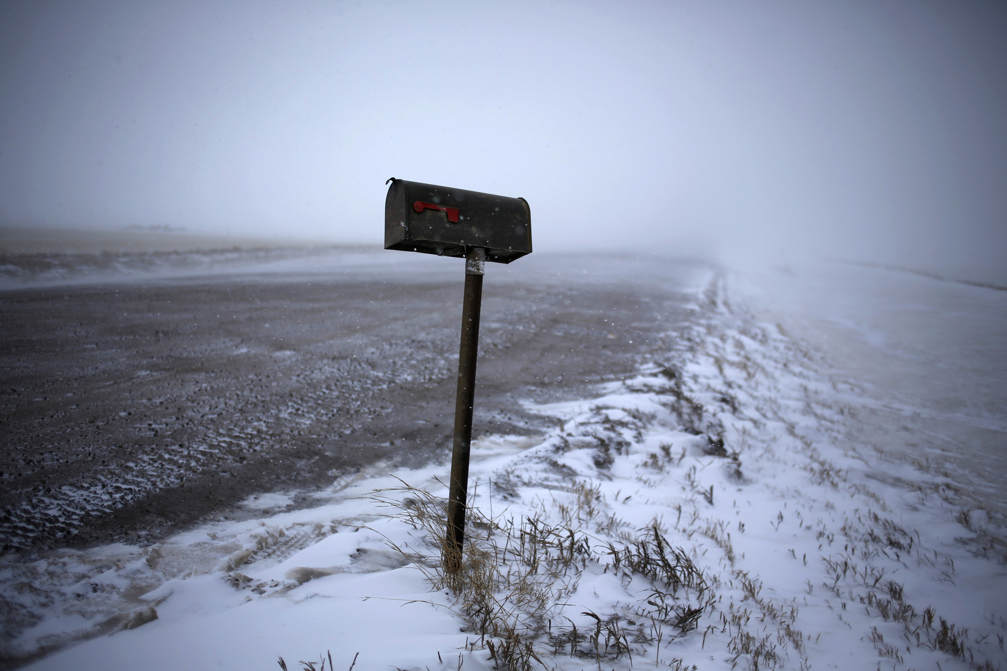 A mailbox is seen along a road during a snowstorm outside of Williston, North Dakota March 11, 2013.