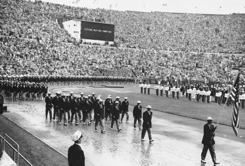 Bobsledder Jim Bickford, carries the American flag during the opening ceremonies for the 1952 games at Oslo.