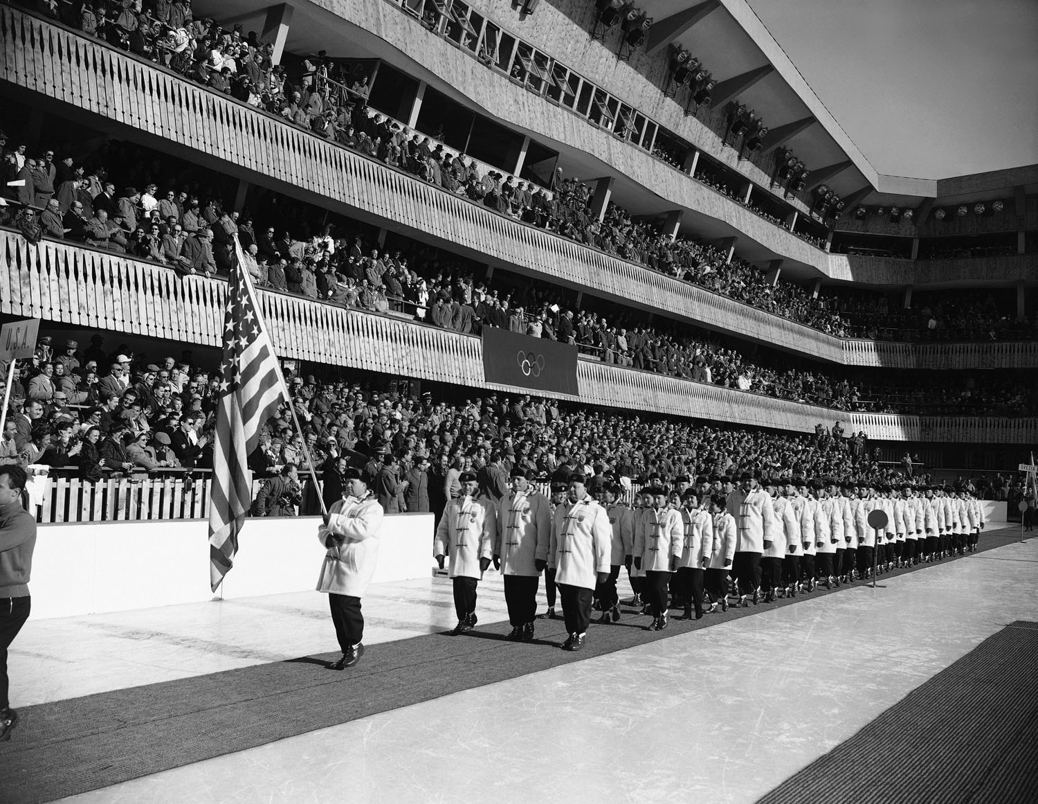 Bobsledder Jim Bickford, carries the U.S. flag again during the opening ceremonies for the 1956 Winter Olympic Games in Cortina D'Ampezzo, Italy.