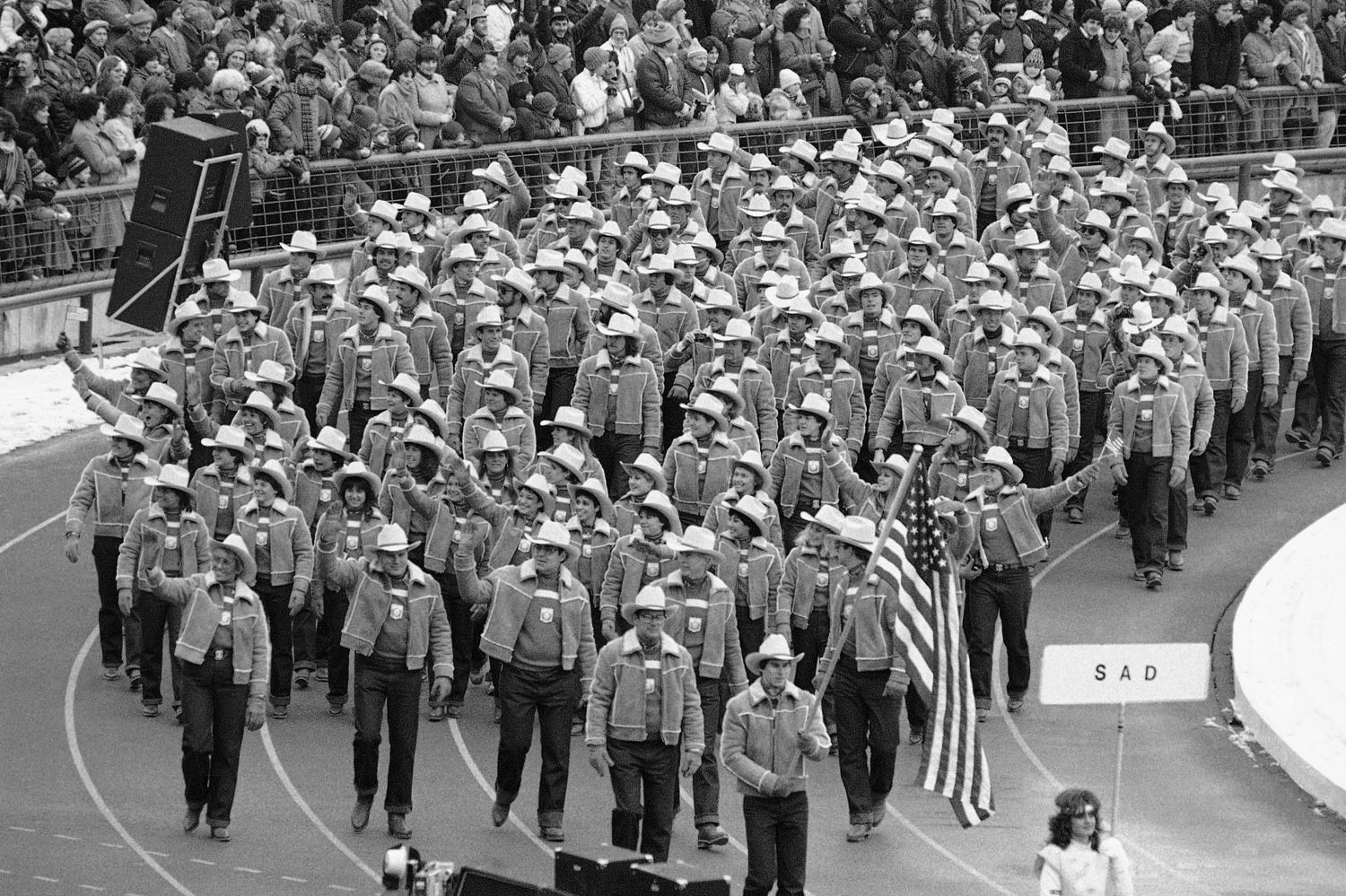 Luger Frank Masley carries the U.S. flag as he and his teammates march during the opening ceremonies of the 14th Winter Olympics in Sarajevo,Yugoslavia, Feb. 8, 1984.
