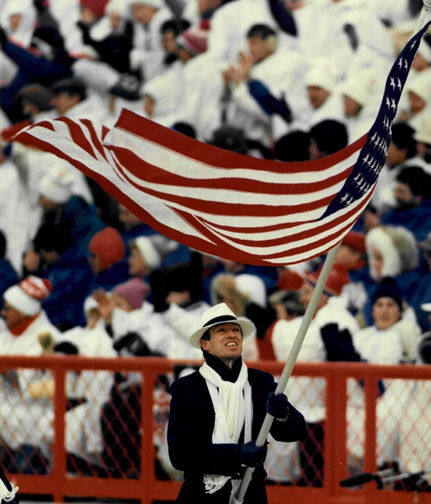Biathlon athlete Lyle Nelson carries the flag during the opening of the 1988 Winter Olympics in Calgary, Aberta, Canada.