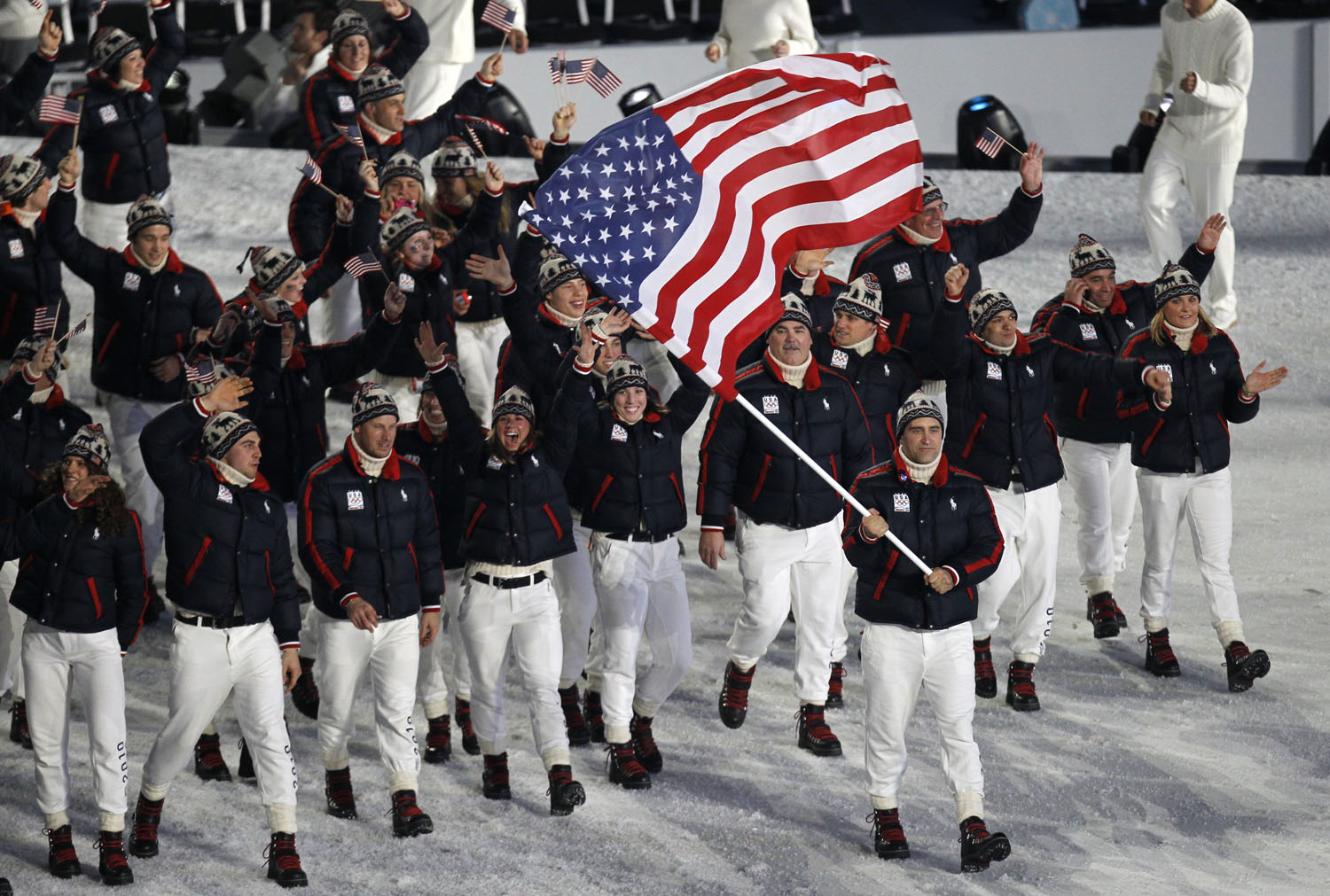 Luger Mark Grimmette bears the American flag and leads his delegation during the opening ceremony of the Vancouver  Winter Olympics, Feb. 12, 2010.