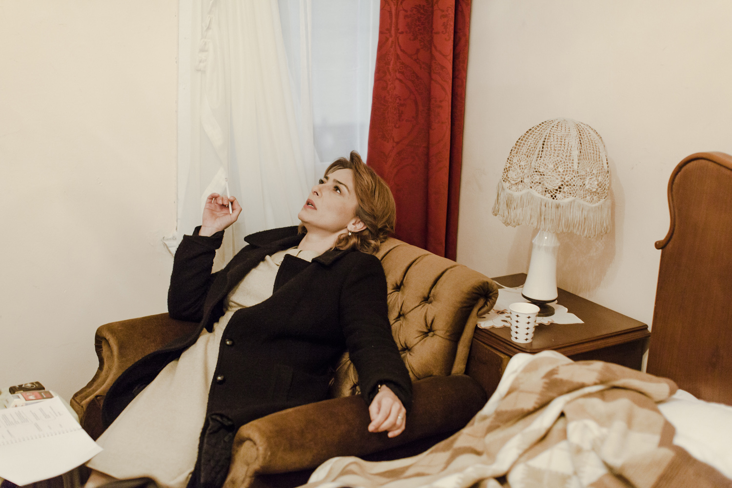 A woman collapses into her chair after a heated argument, Beykoz, Istanbul, February 2013.