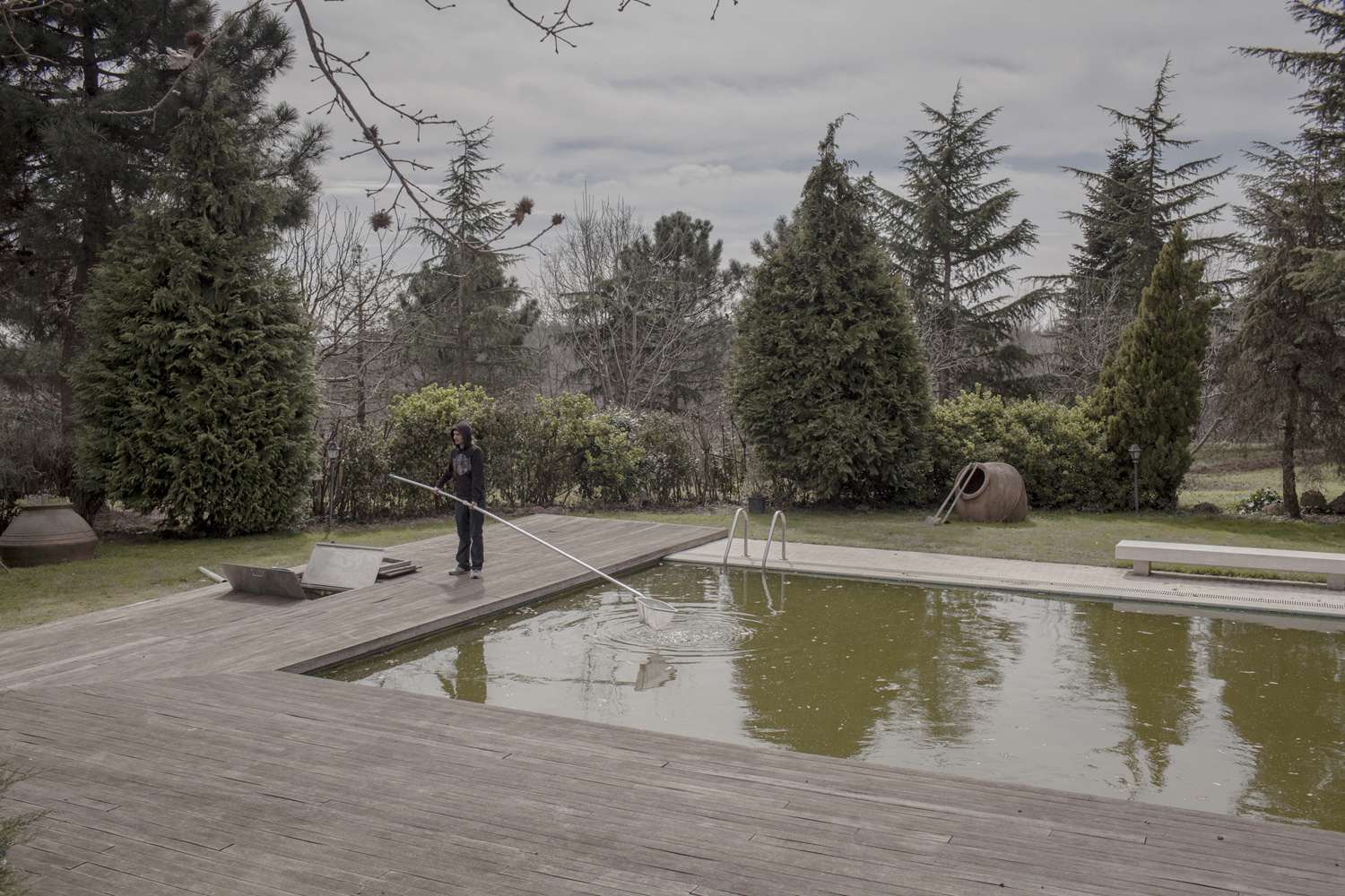 The swimming pool of a wealthy resident of Istanbul is cleaned for filming, March 2013.