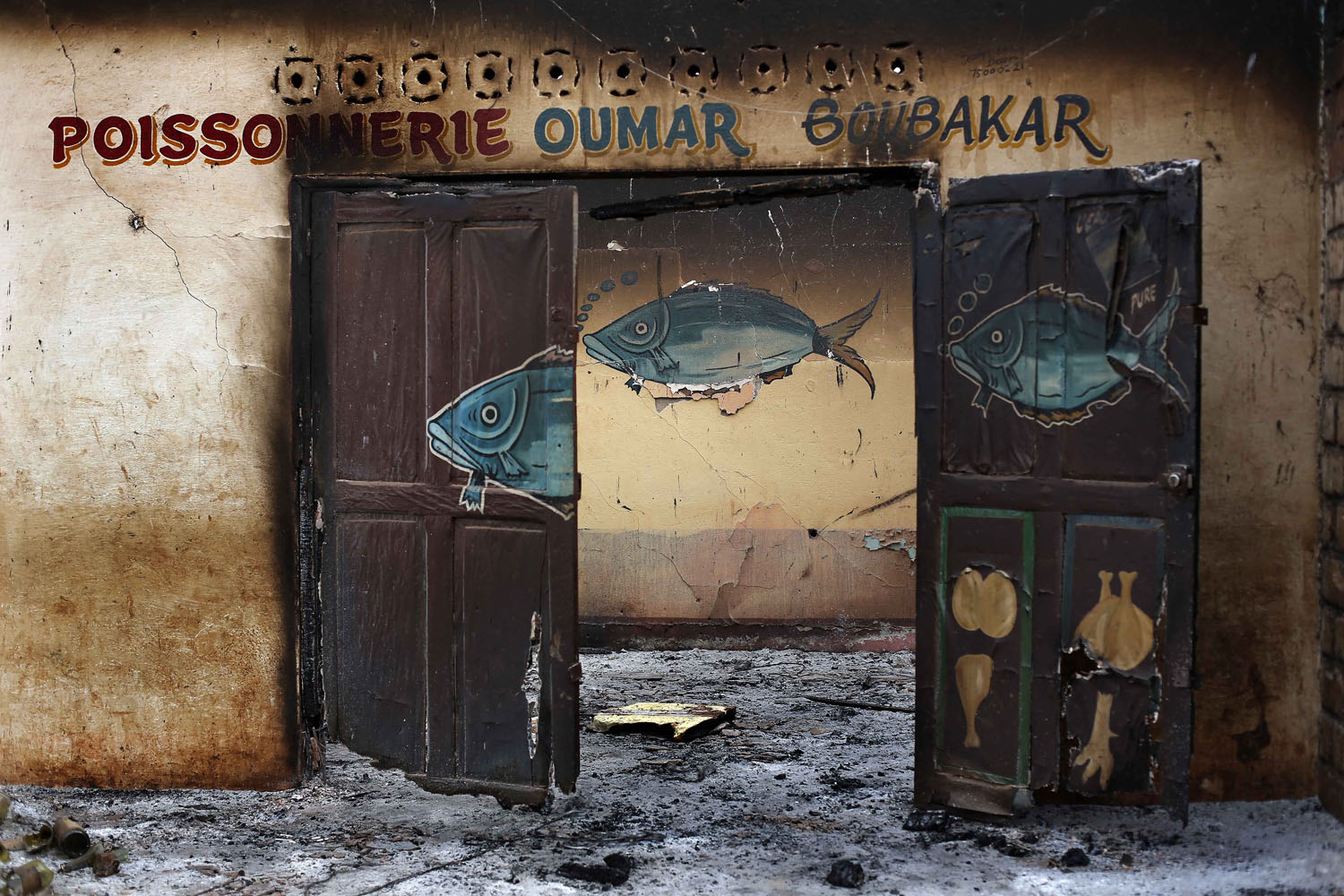 The following photos were taken Feb. 4, 2014 in Bangui, Central African Republic: A Muslim-owned fish shop stands looted in the Miskin district of Bangui.
