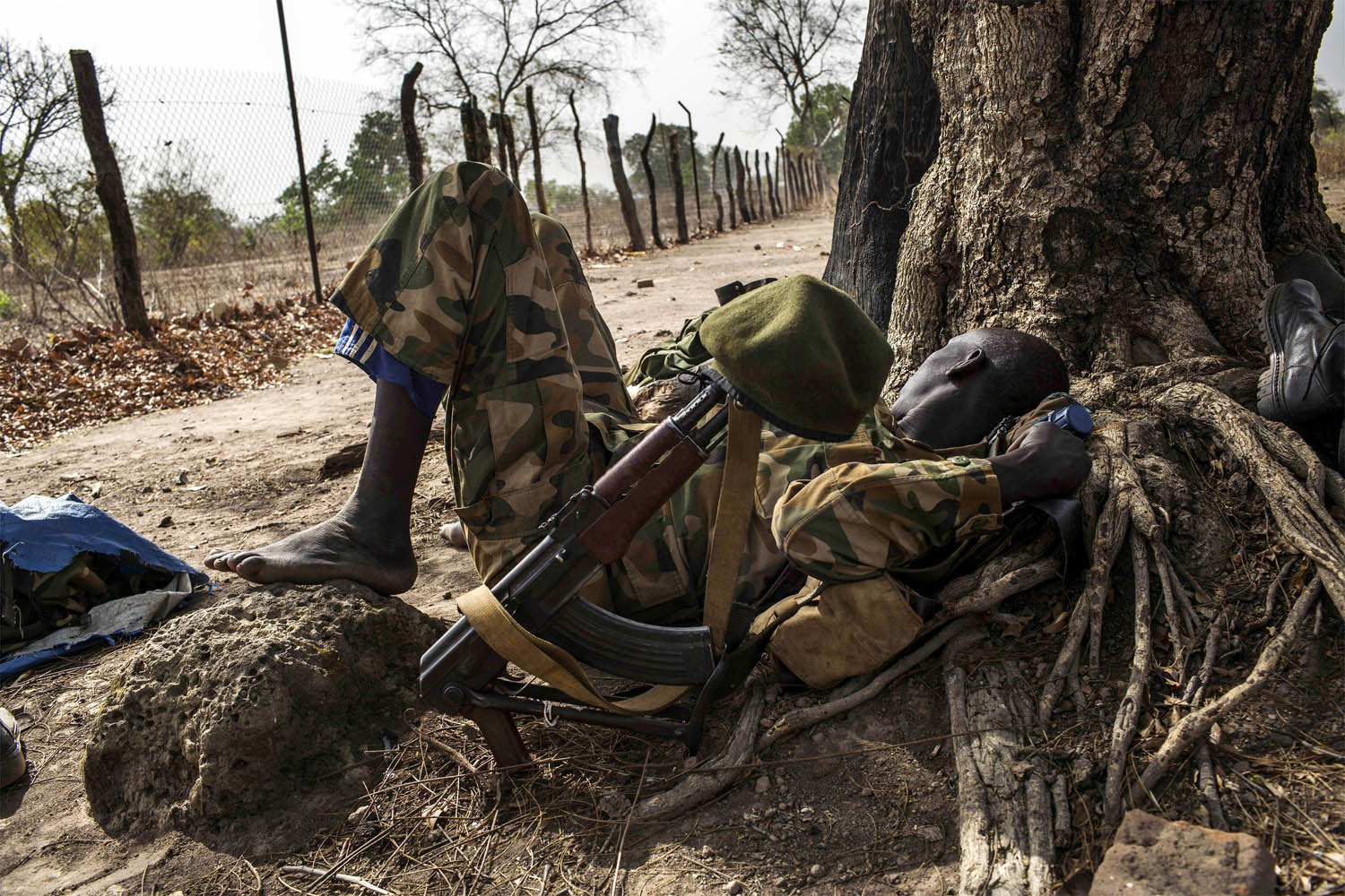 Feb. 15, 2014. A Sudan People's Liberation Army (SPLA) government soldier from the 2nd Battalion rests under a tree at the SPLA headquarters in Nyang, in the county of Yirol East, South Sudan.