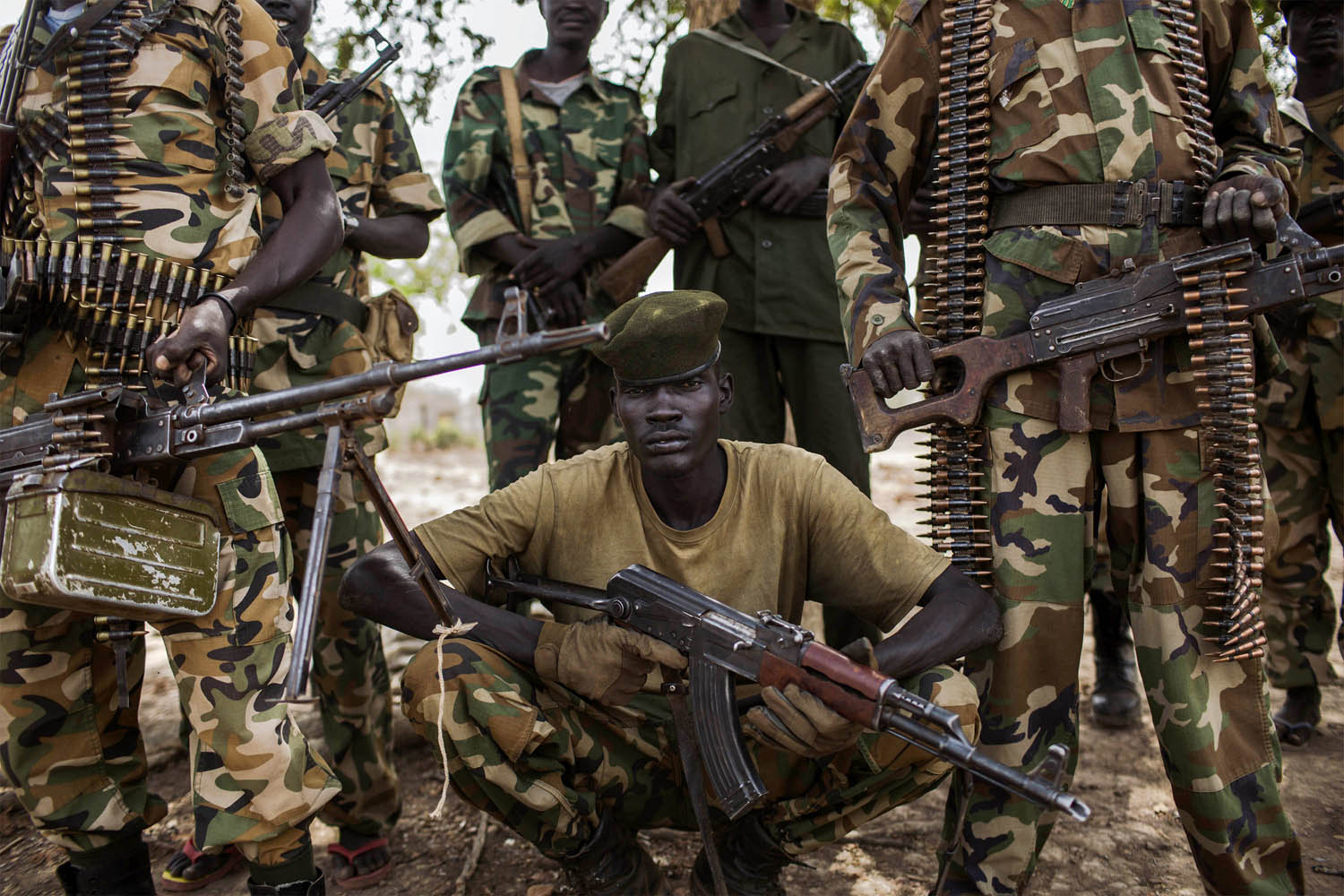 Feb. 15, 2014. Sudan People's Liberation Army (SPLA) government soldiers from the 2nd Battalion pose at the SPLA headquarters in Nyang, in the county of Yirol East, South Sudan.