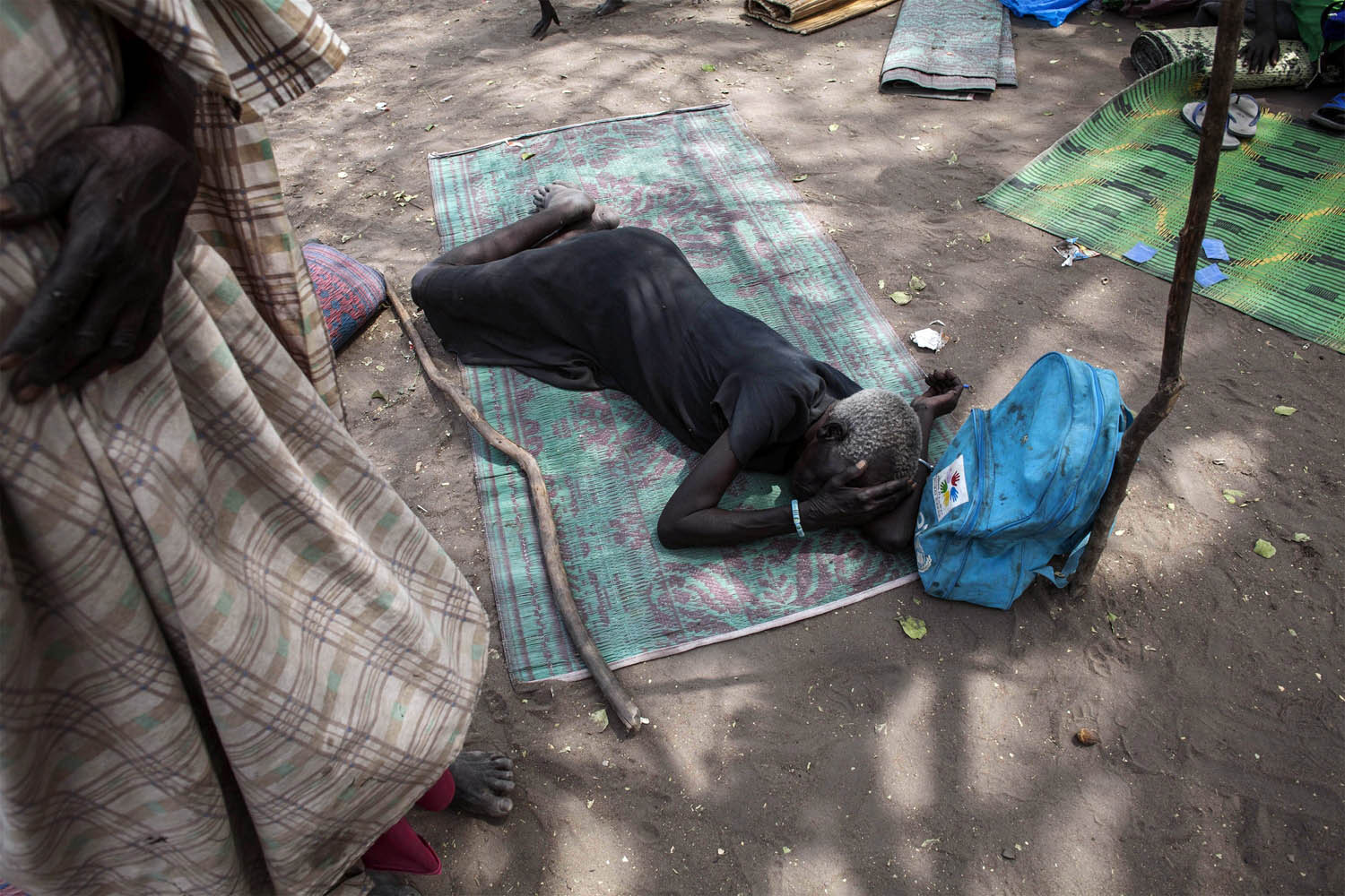 Feb. 5, 2014. A South Sudanese woman lies on the floor in a temporary camp for internally displaced persons in Mingkaman, South Sudan