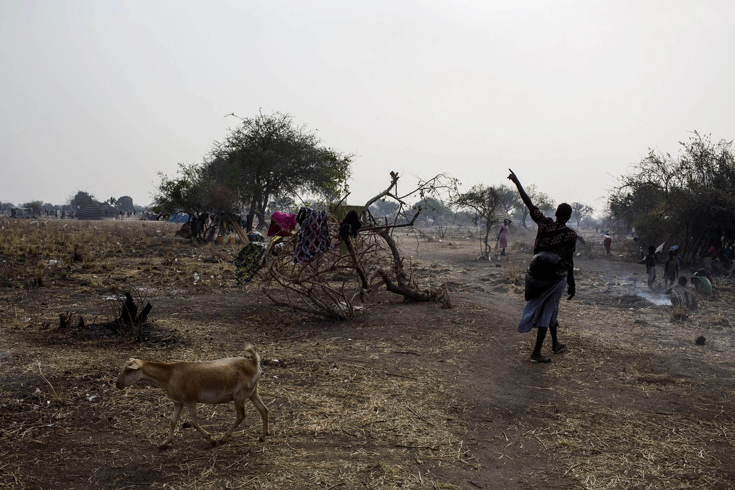Feb. 7, 2014. A South Sudanese Internally Displaced Person (IDP) walks in the temporary camp in Mingkaman, South Sudan.