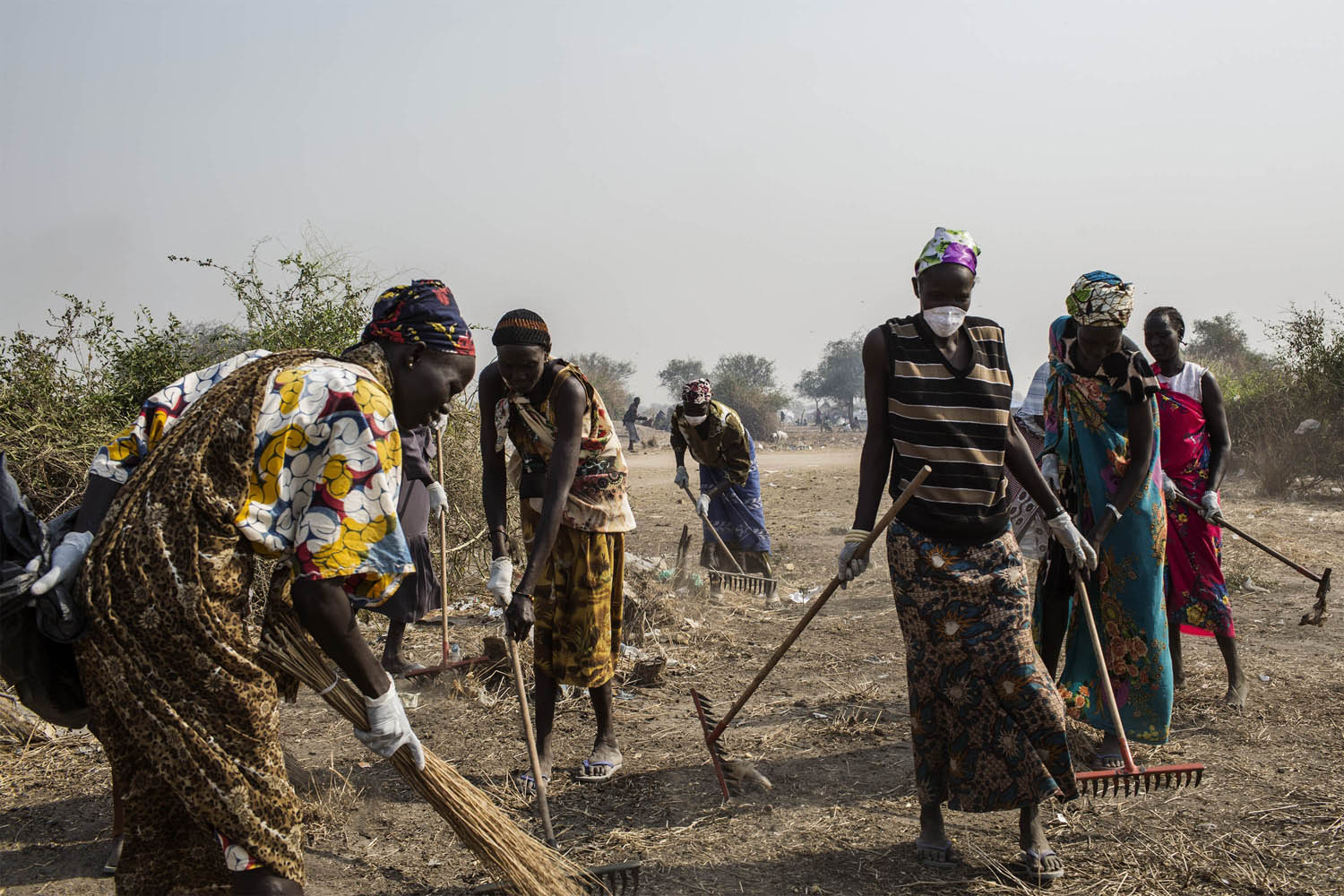 Feb. 7, 2014. South Sudanese Internally Displaced People (IDP's) clean the temporary camp in Mingkaman, South Sudan.