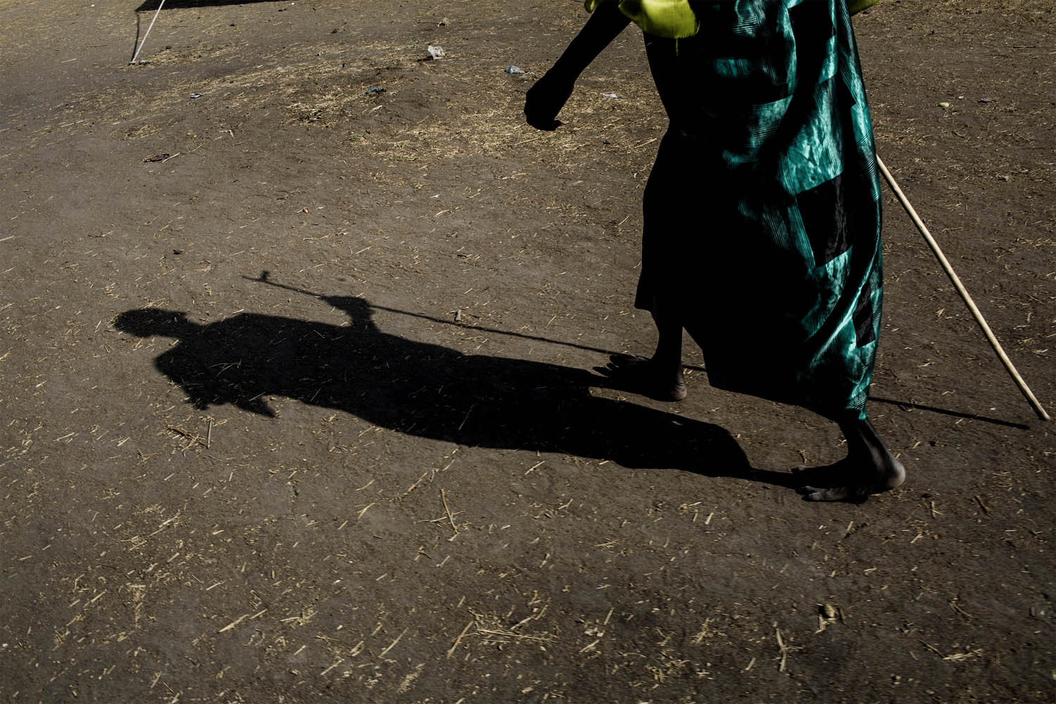 Feb. 7, 2014. A person walks in the temporary camp of South Sudanese Internally Displaced People (IDP's) in Mingkaman, South Sudan.