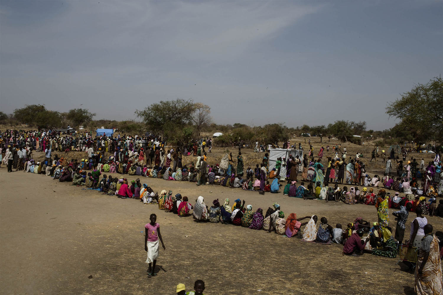 Feb. 9, 2014. South Sudanese internally displaced people (IDP) wait to be registered on the list of the World Food Program (WFP) at Mingkaman's temporary camp, South Sudan.