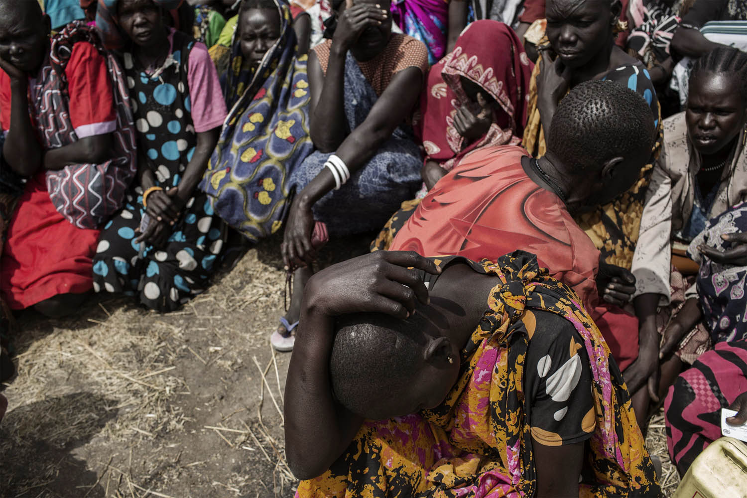 Feb. 7, 2014. South Sudanese internally displaced people (IDP) wait to be registered on the list of the World Food Program (WFP) at Mingkaman's temporary camp, South Sudan.