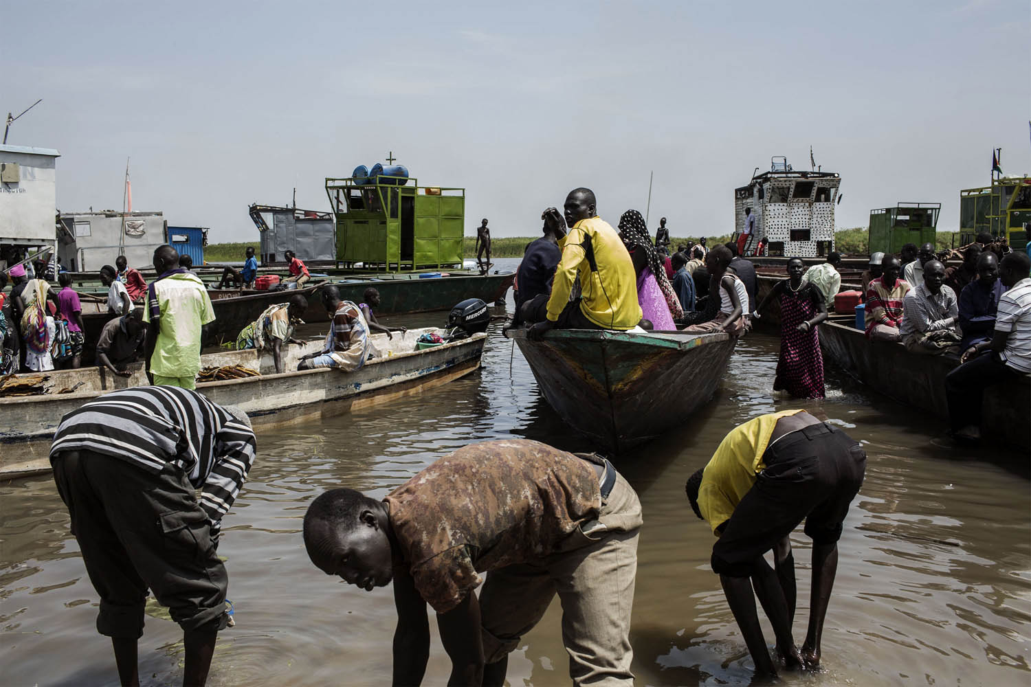 Feb. 9, 2014. South Sudanese internally displaced people (IDP) get on boats at Mingkaman's temporary camp, as they head back to Bor, South Sudan.