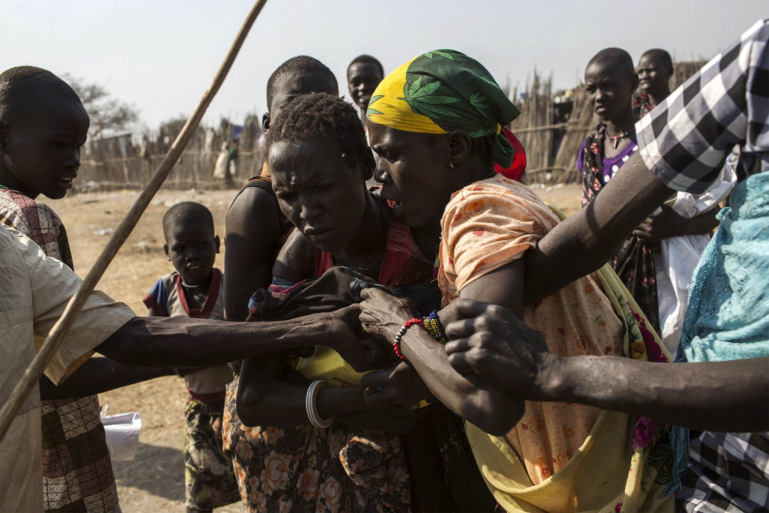 Feb. 9, 2014. South Sudanese internally displaced people (IDP) fight for food supplies, distributed by the International Committee of the Red Cross (ICRC)  at the Mingkaman temporary camp, South Sudan.