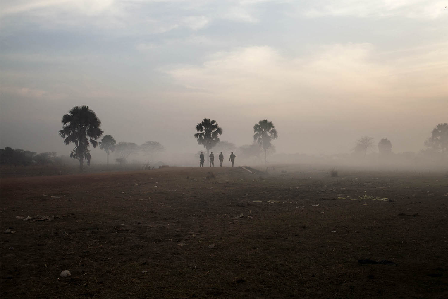 Feb.12, 2014.. Government soldiers walk along the road that connects the central South Sudanese town of Yirol with the north of the country.