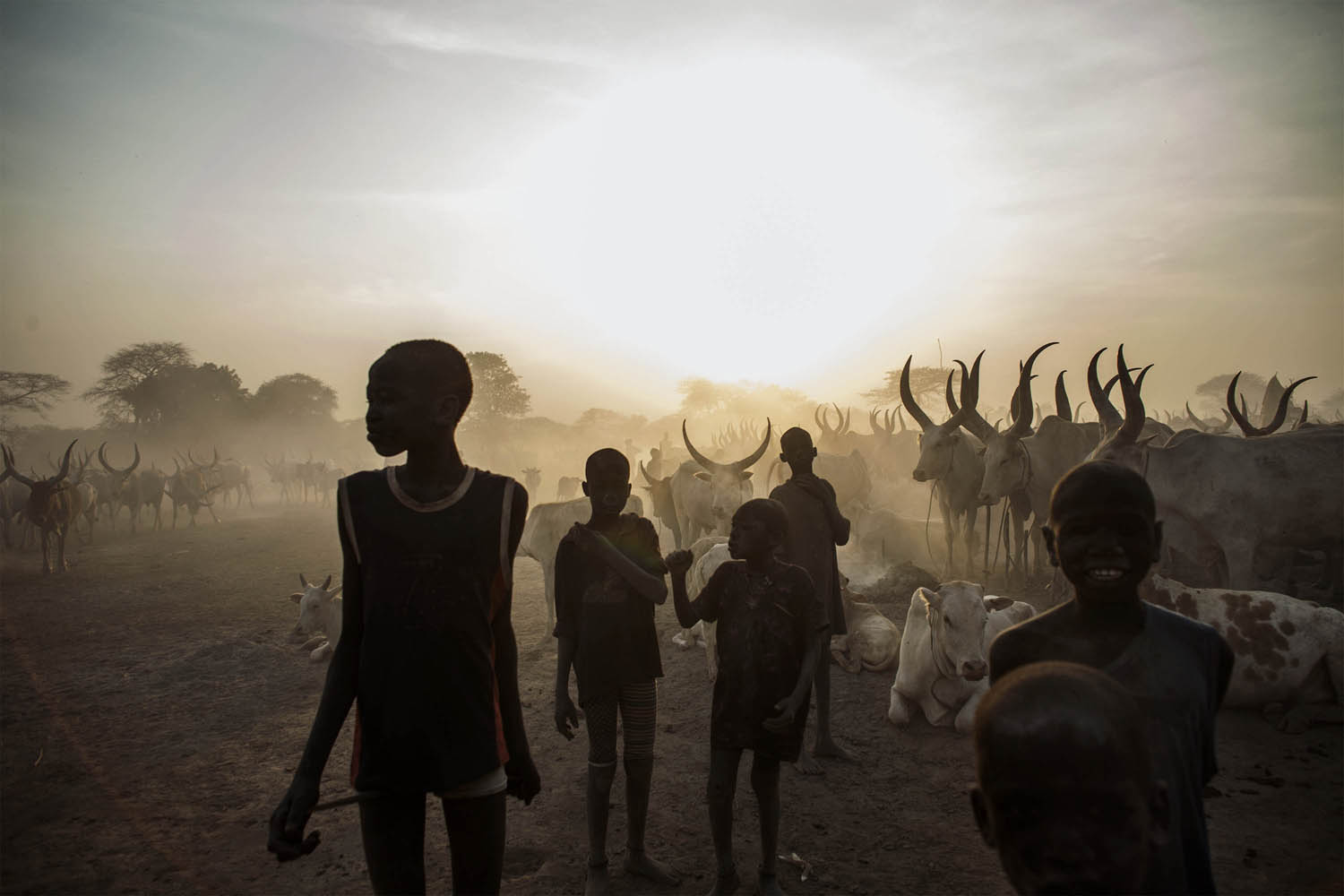 Feb. 12, 2014.. South Sudanese children from the Dinka ethnic group pose at cattle camp in the town of Yirol, in central South Sudan.