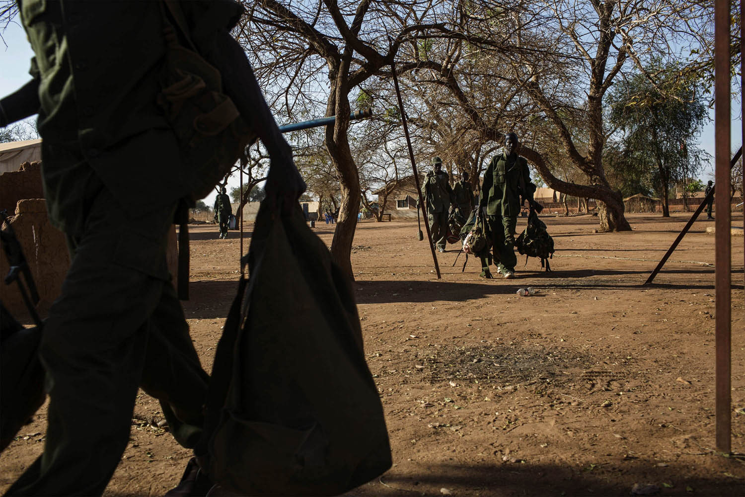 Feb. 14, 2014. Sudan People's Liberation Army (SPLA) government soldiers from the 2nd Brigade 6th Division prepare to go on a patrol at the SPLA headquarters near Yirol, South Sudan,