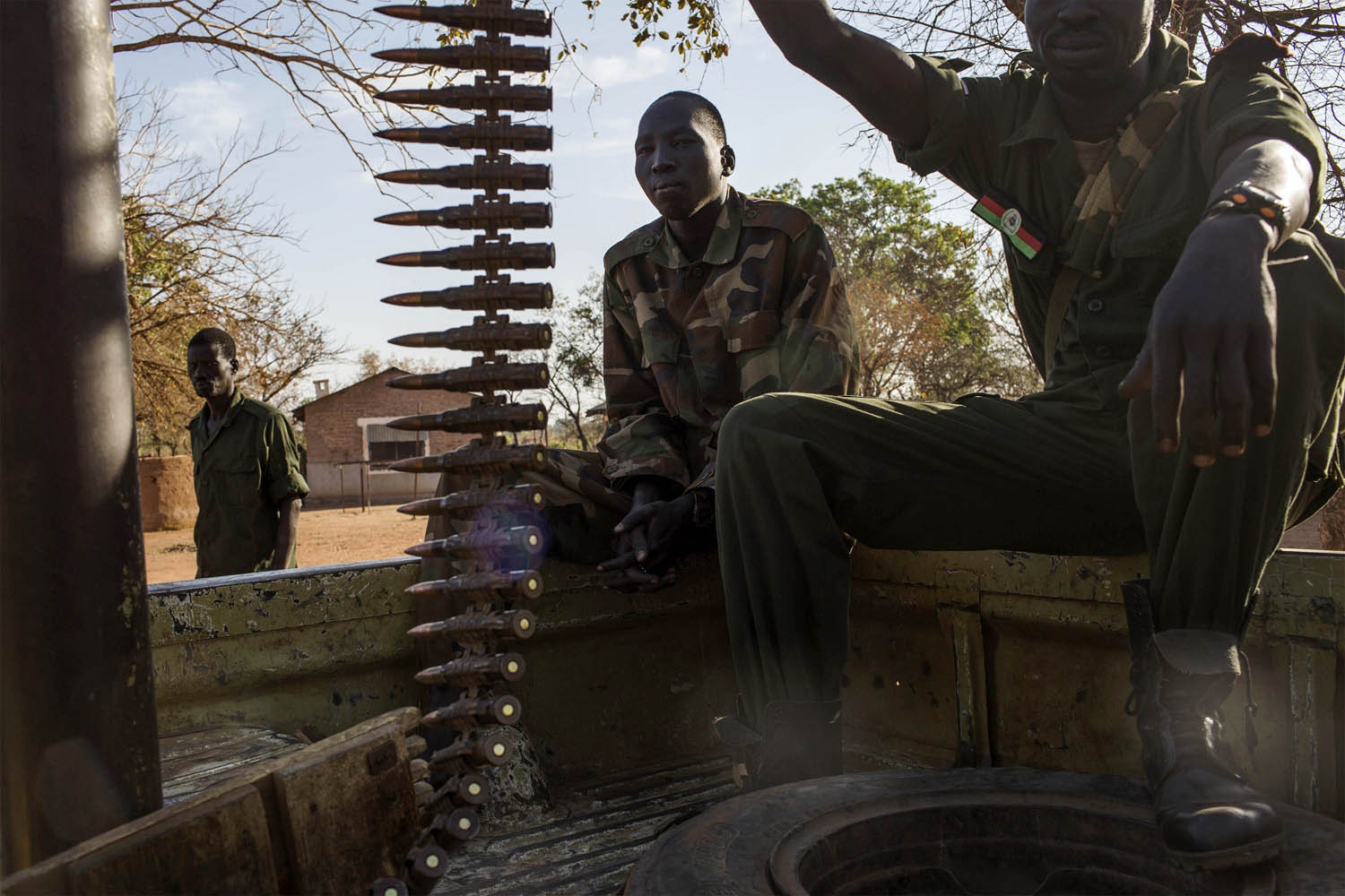 Feb. 14, 2014. Sudan People's Liberation Army (SPLA) government soldiers from the 2nd Brigade 6th Division sit on a truck with a heavy machine gun at the SPLA headquarters near Yirol, South Sudan,