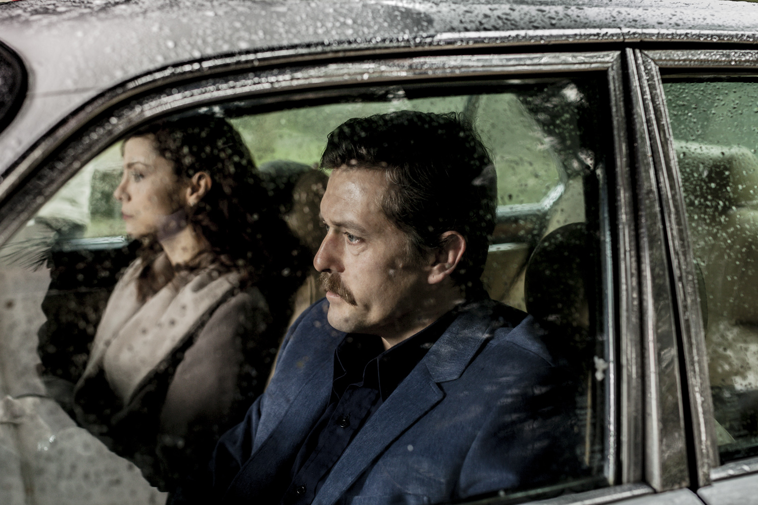A man and his wife sit in a car on the outskirts of Istanbul preparing for a journey downtown, February 2013.