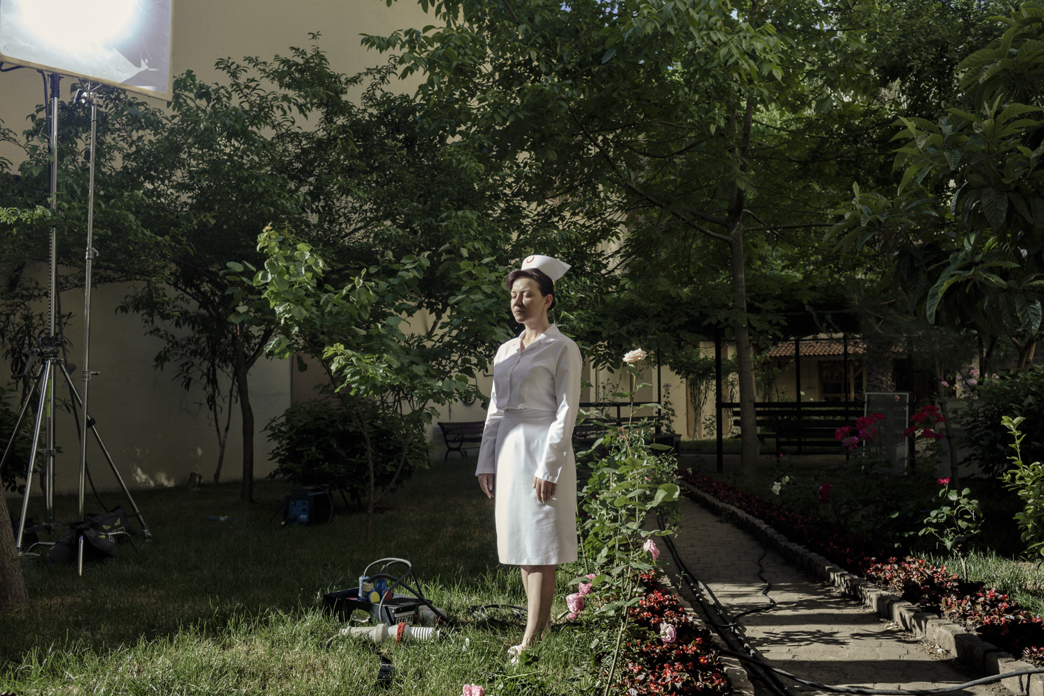 """A woman stands in a school in the Sulthanehamet district of Istanbul during the filming of  Oyle Bir Gecer Zaman Ki,  or  As Time Goes By,"""" one of the most loved and most watched Turkish soap operas in the Middle East and North Africa, May 2013."""