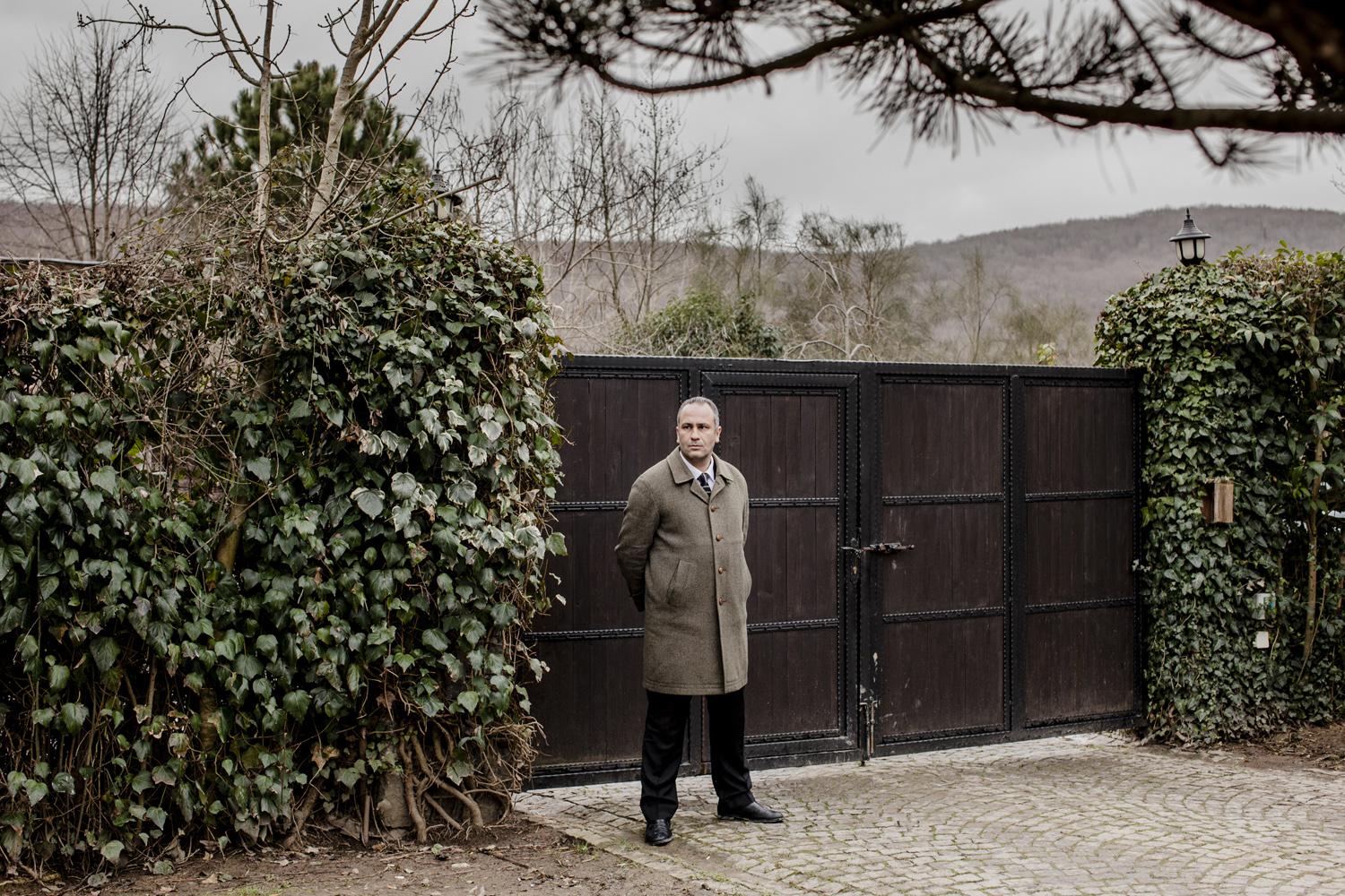 A man from a private security firm stands guard at the home of a wealthy Istanbul resident, February 2013.