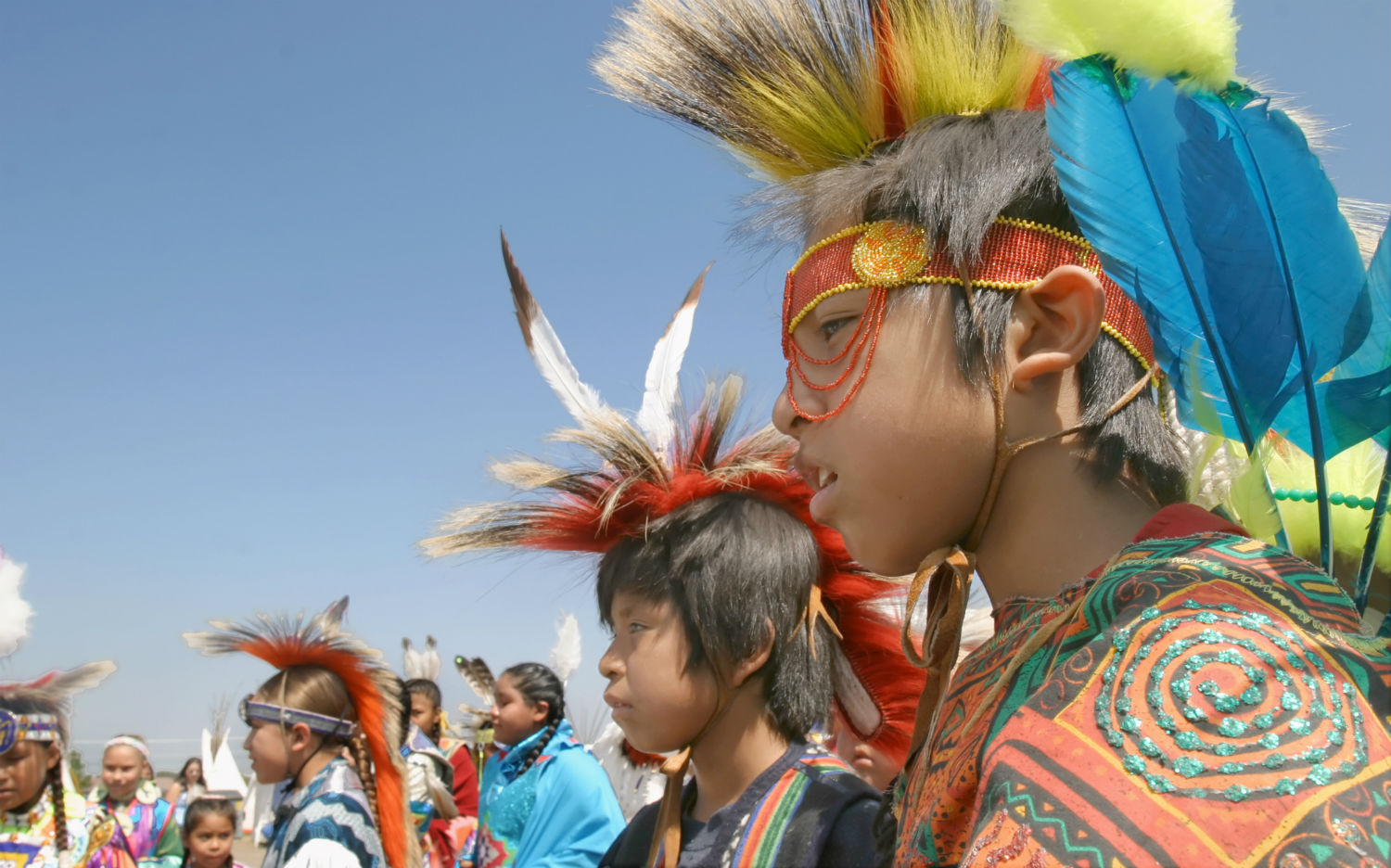 Young men wait to take part in an annual pow wow and rodeo in Toppenish, Wash. The boys are members of the Coleville and Yakama tribes.