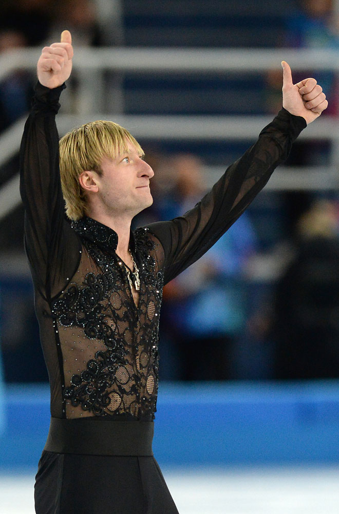 Russia's Yevgeni Plushenko reacts after performing the Men's Figure Skating Team Free Program at the Iceberg Skating Palace during the Sochi Winter Olympics on February 9, 2014.