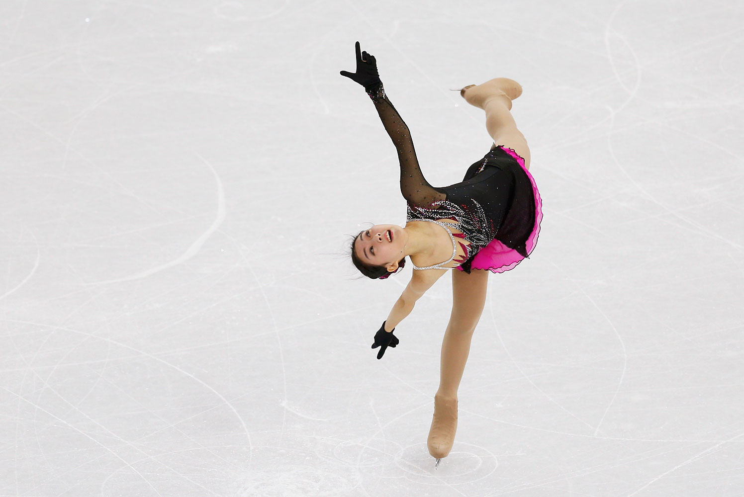 China's Zijun Li competes during the Figure Skating Women's Short Program at the Sochi 2014 Winter Olympics, Feb. 19, 2014