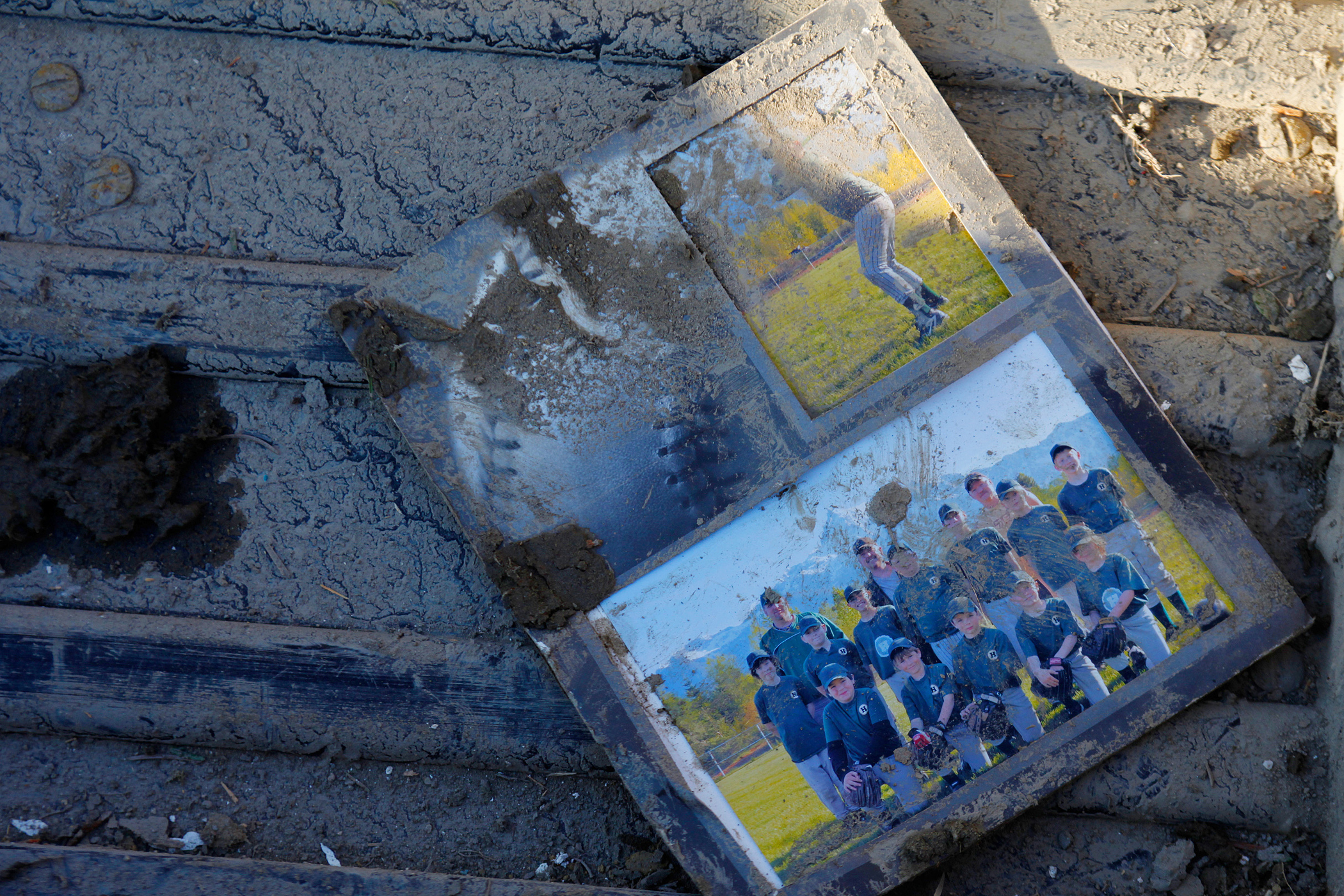 Mud splattered pictures in a home effected by Saturday's fatal mudslide near Oso, Wash., March 23, 2014.