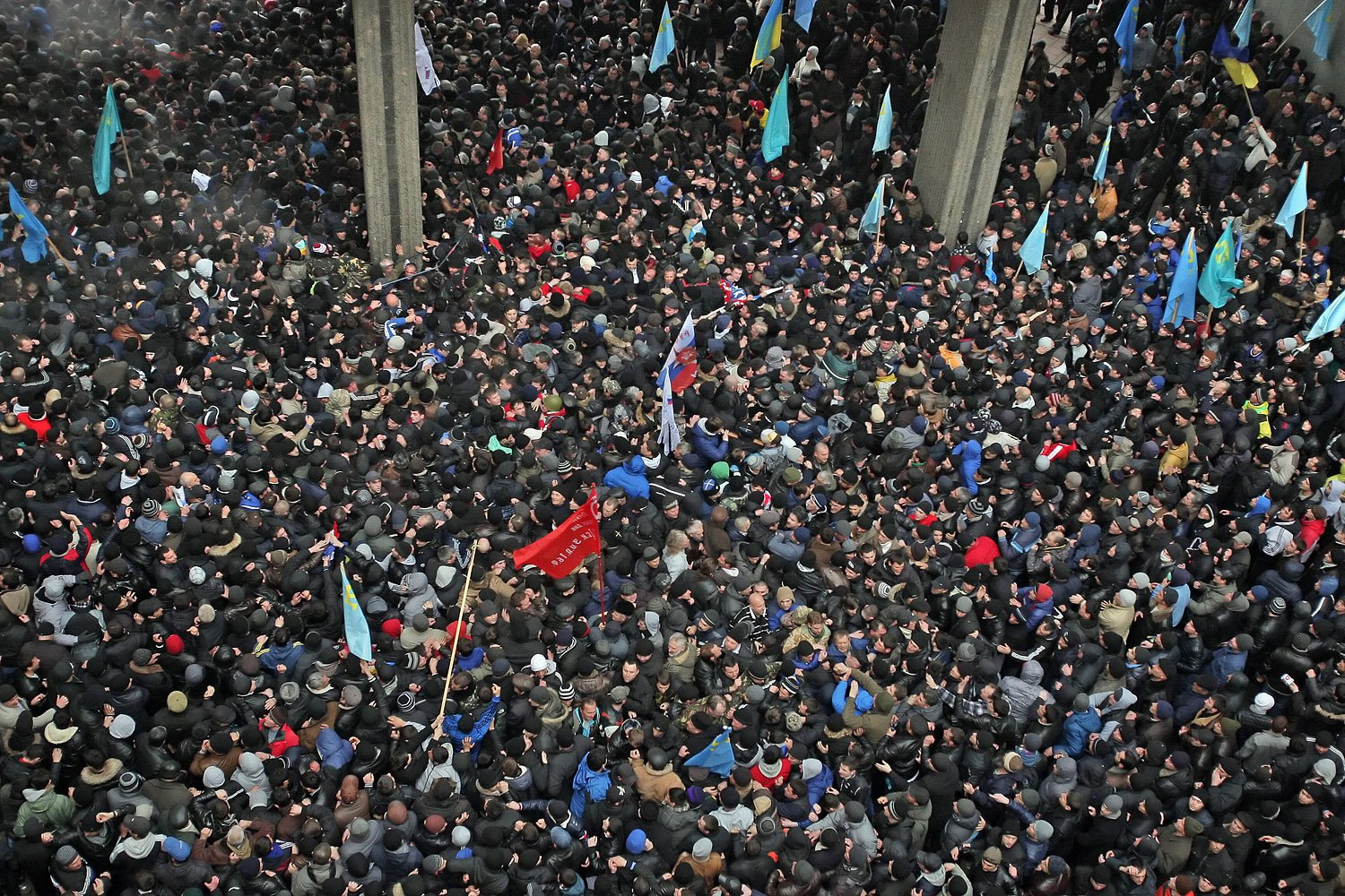 Ukrainian and Russian supporters clash during a protest near the Parliament building in Simferopol, Feb. 26, 2014.