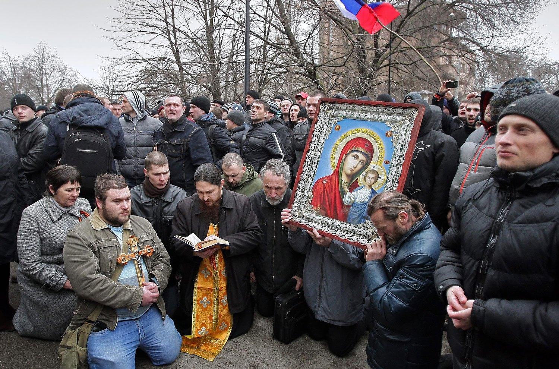 Pro-Russian activists pray near the Crimean Parliament building in Simferopol, Feb. 26, 2014.