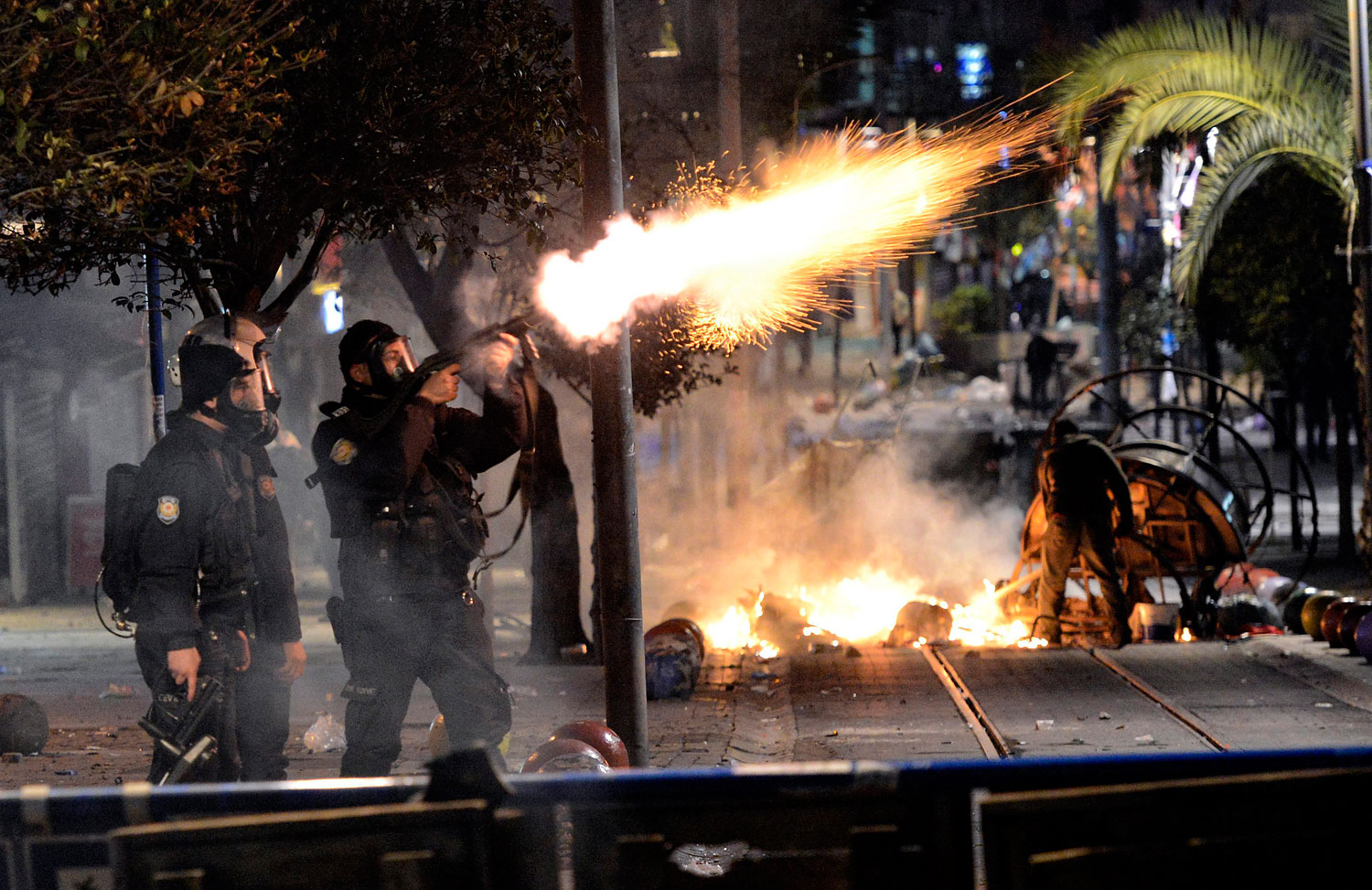 Turkish riot police fires tear gas to disperse protesters during a demonstration in Istanbul, March 11, 2014.