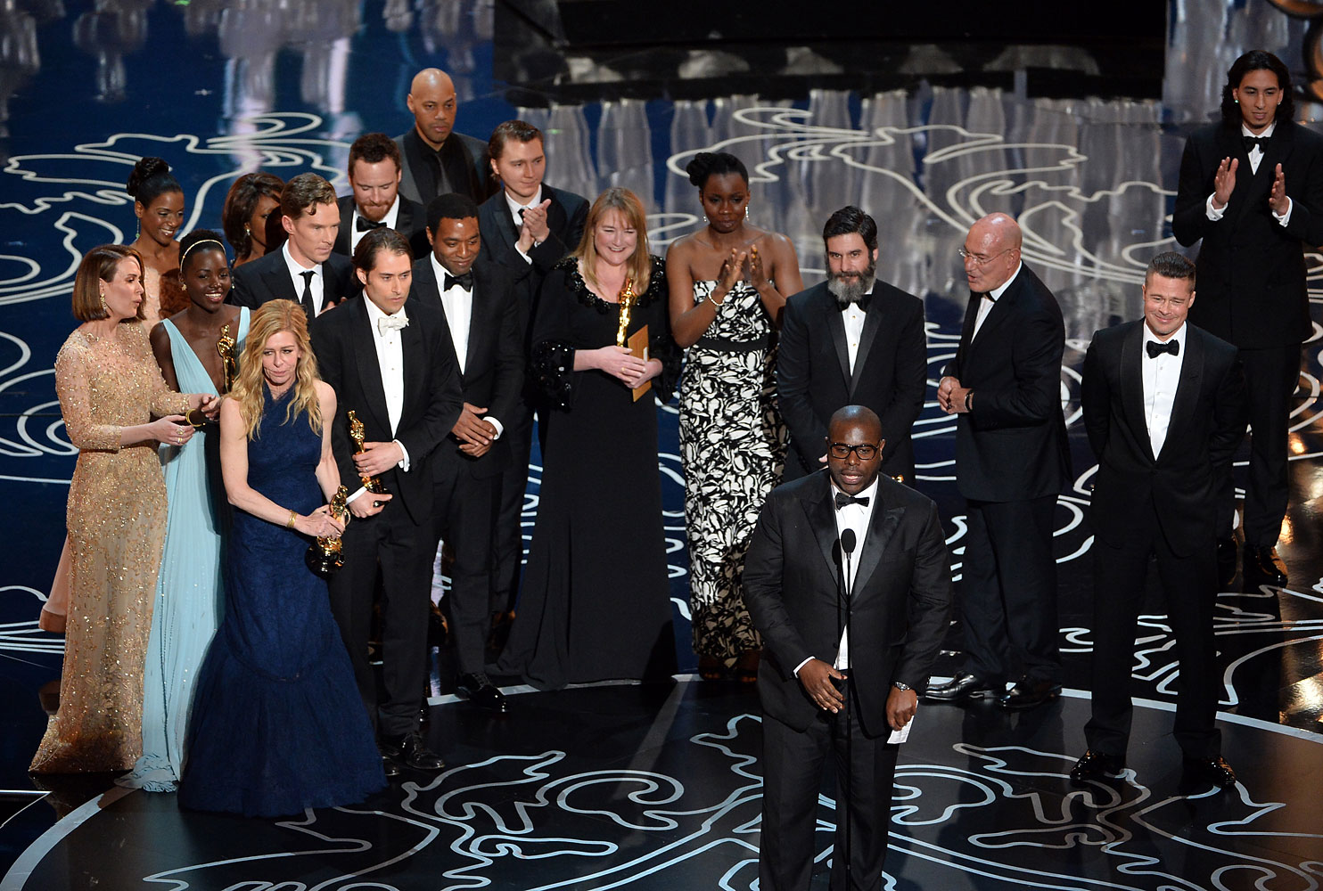 Director Steve McQueen (C) accepts the Best Picture award for '12 Years a Slave' onstage during the Oscars at the Dolby Theatre on March 2, 2014 in Hollywood, California.