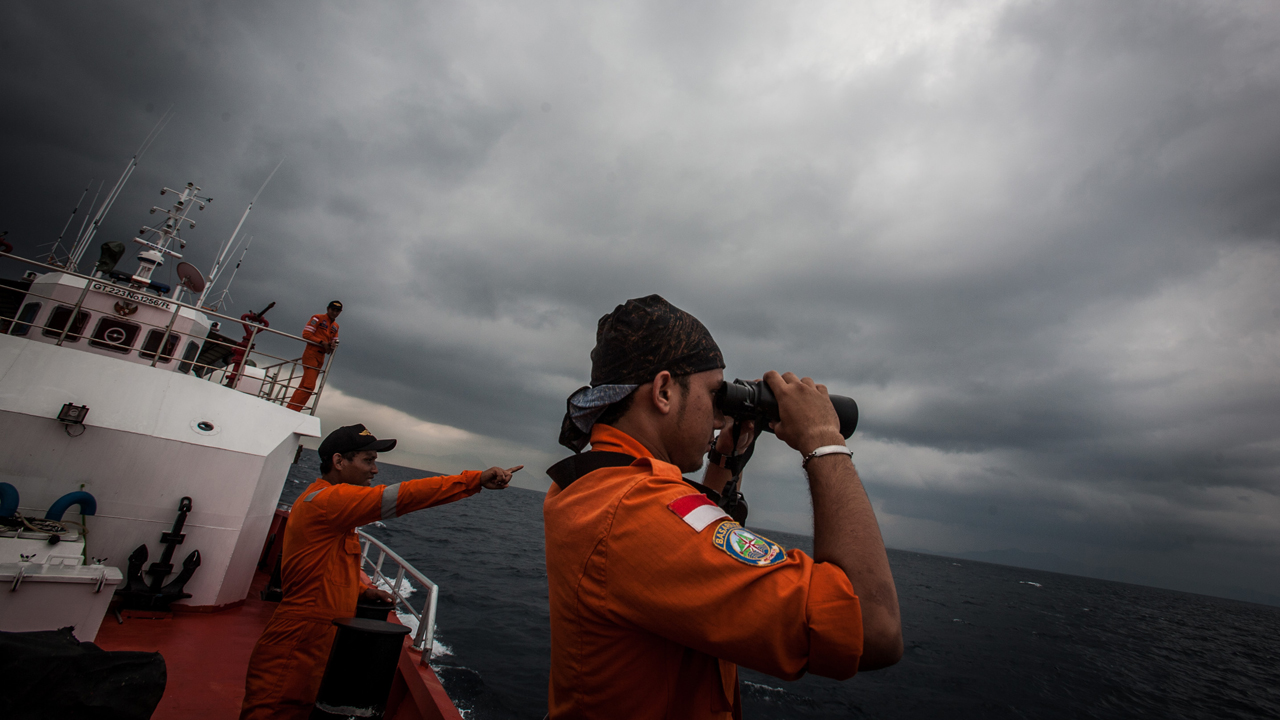Indonesian national search and rescue agency personel watch over high seas during a search operation for missing Malaysia Airlines flight MH370 in the Andaman Sea on March 15, 2014. Investigators now believe a Malaysian jet that vanished was commandeered by a  skilled, competent  flyer who piloted the plane for hours, a senior Malaysian military official said on March 15 as Prime Minister Najib Razak prepared to address the nation. AFP PHOTO/ Chaideer MAHYUDDIN        (Photo credit should read CHAIDEER MAHYUDDIN/AFP/Getty Images)