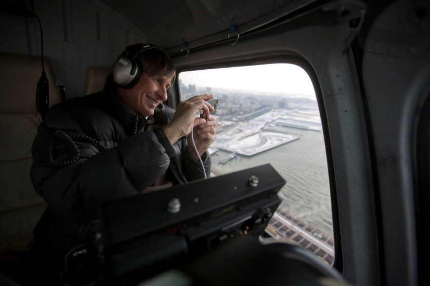 Aerial cinematographer Doug Holgate snaps a photo with his iPHone while flying over the Brooklyn Bridge