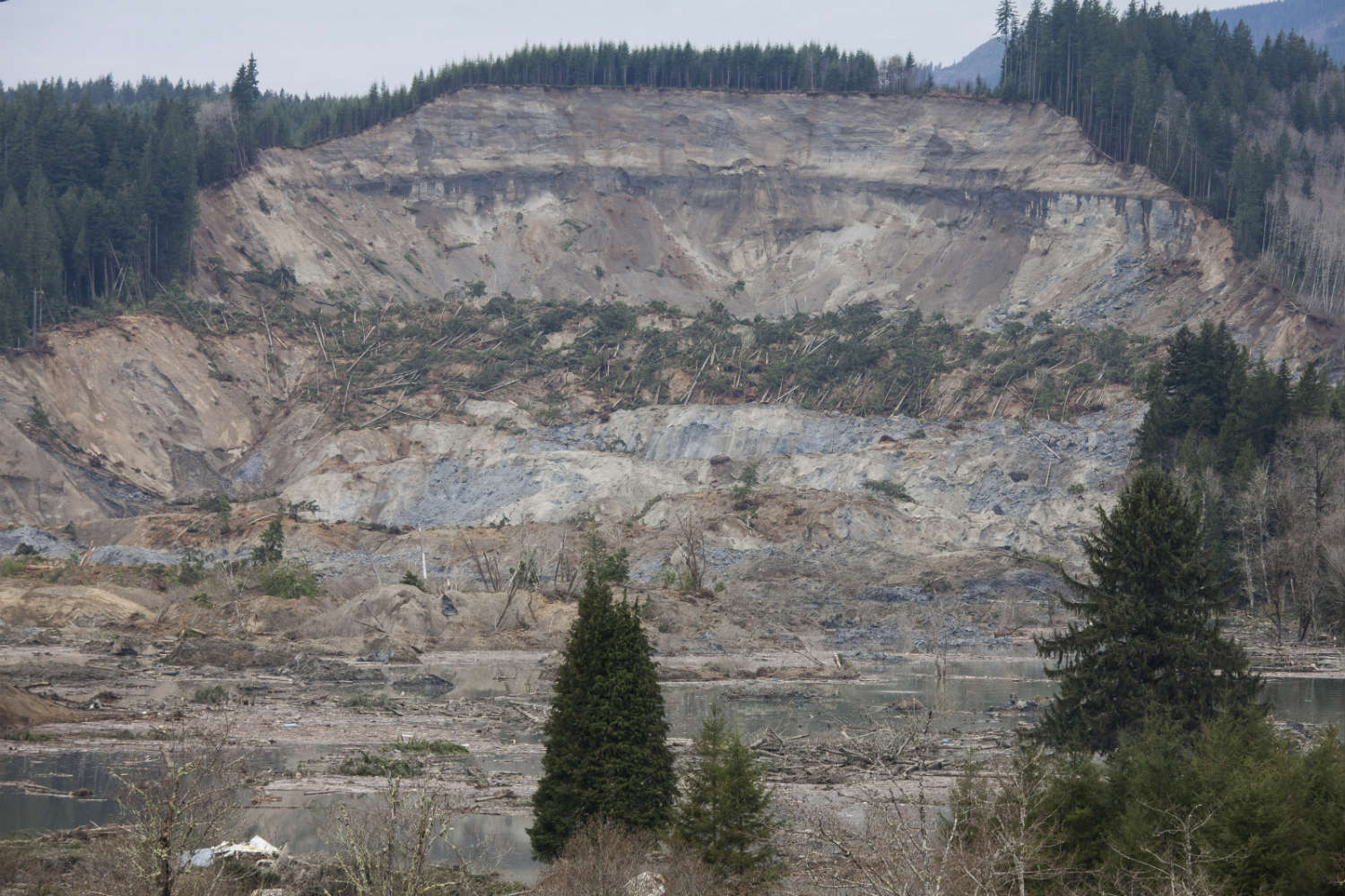A massive landslide near Oso, Washington killed at least 16 people, with far more still missing