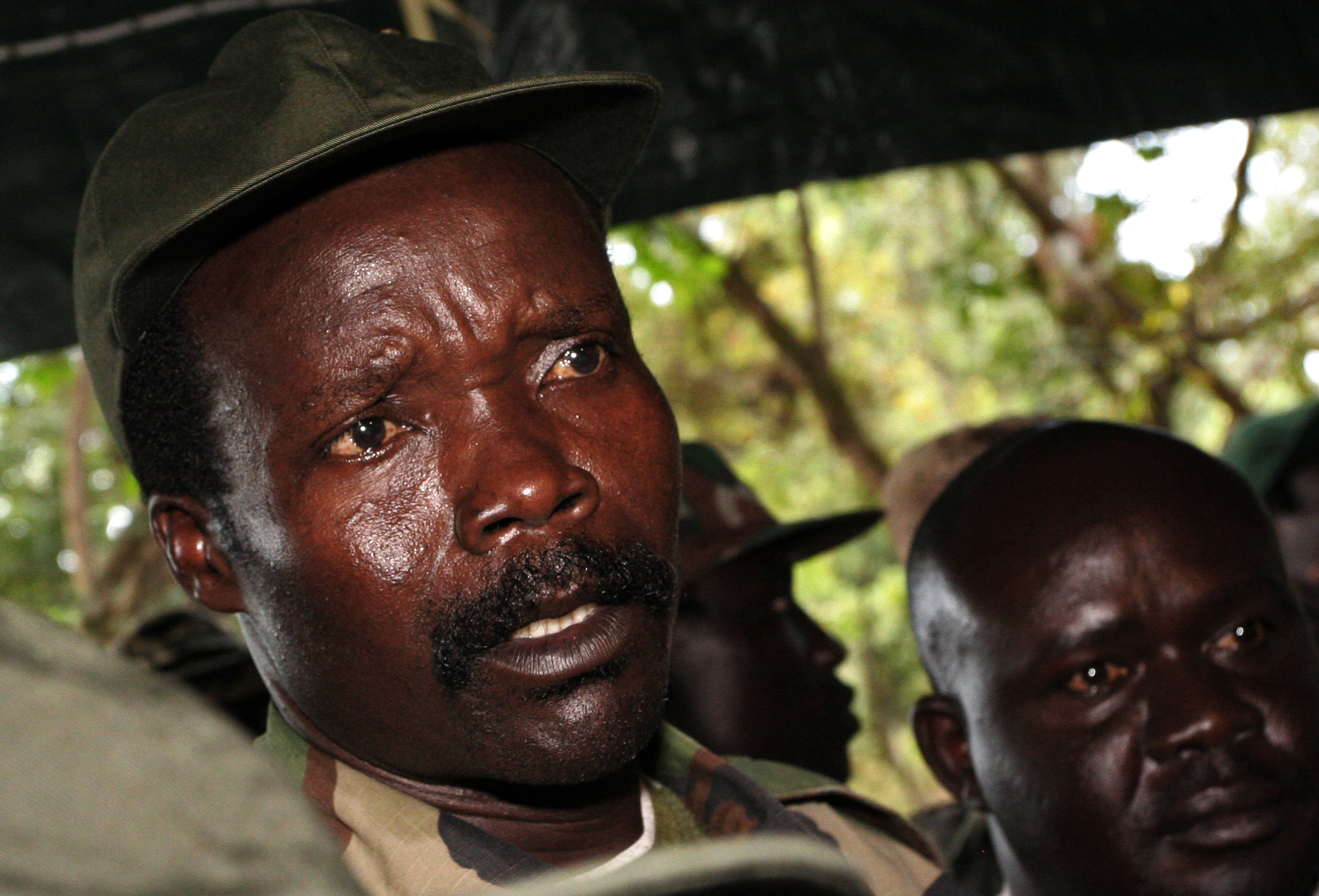 Joseph Kony of the Lord's Resistance Army answers journalists' questions in Ri-Kwamba, Sudan, on Nov. 12, 2006