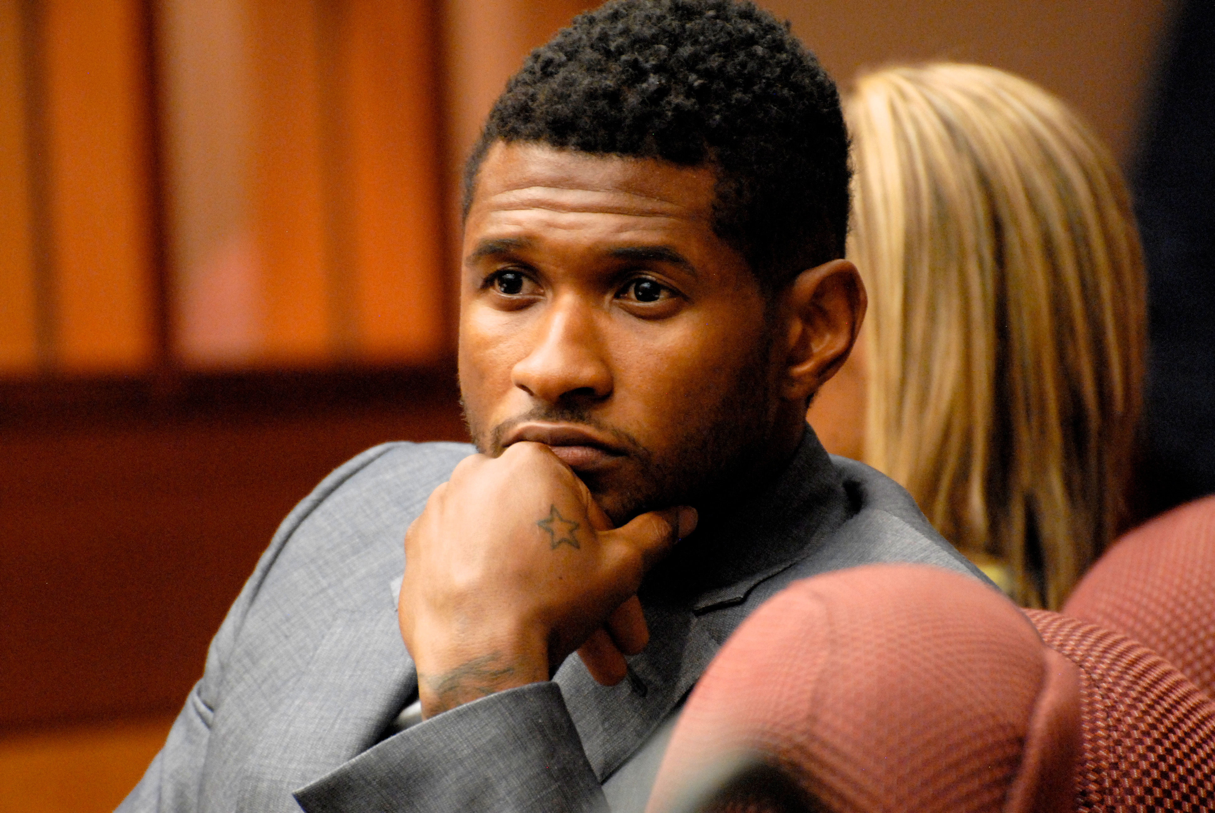 Usher Raymond attends a hearing to discuss child custody with his ex-wife Tameka Foster at Fulton County State Court on August 16, 2012 in Atlanta, Georgia.