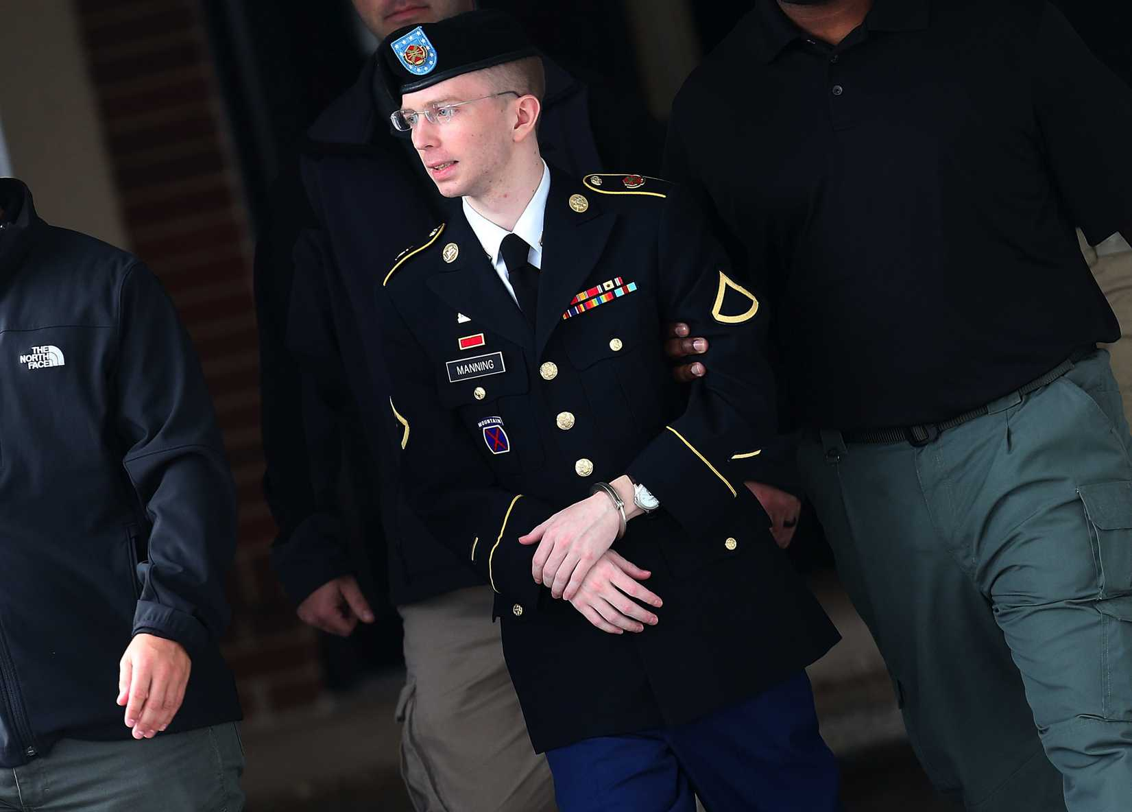 U.S. Army Private First Class Bradley Manning is escorted out of a military court during the sentencing phase of her trial in Fort Meade, Md., on Aug. 20, 2013