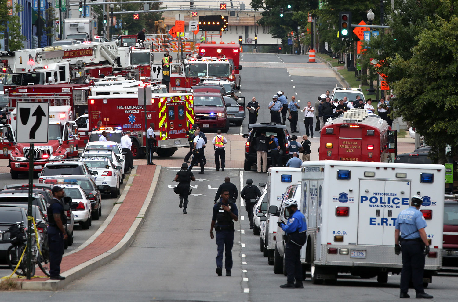 Emergency vehicles and law enforcement personnel respond to a shooting at an entrance to the Washington Navy Yard, Sept. 16, 2013 in Washington, DC.
