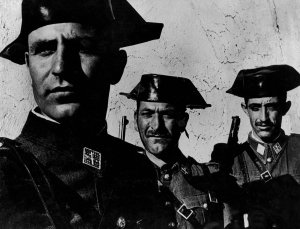 """In the single most famous image from W. Eugene Smith's magisterial photo essay, """"Spanish Village,"""" the faces of three members of dictator Francisco Franco's feared Guardia Civil evince the arrogance often assumed by small men granted great power over others."""