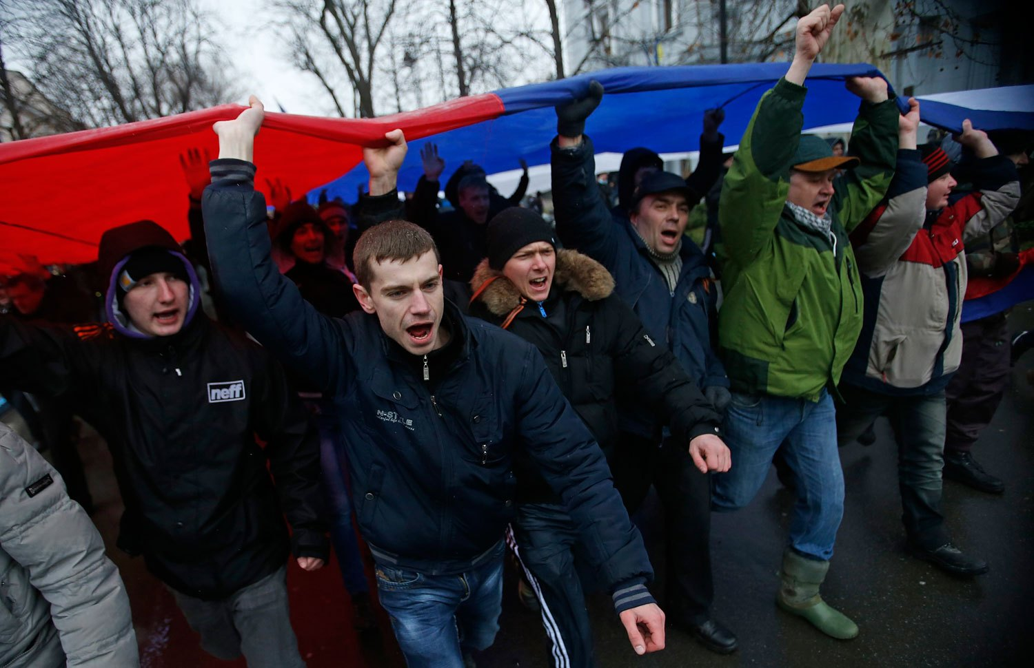 People carry a giant Russian flag during a pro-Russian rally in Simferopol, Feb. 27, 2014.