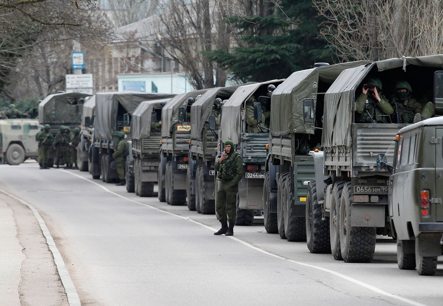 Armed servicemen wait in Russian army vehicles in the Crimean town of Balaclava, March 1, 2014.