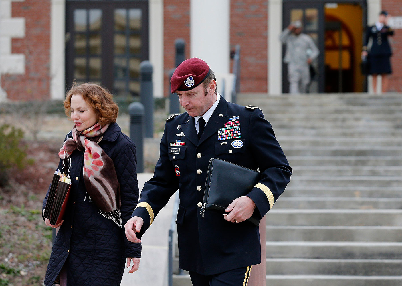 Army Brigadier General Jeffrey Sinclair leaves the courthouse with one of his attorneys at Fort Bragg in Fayetteville, N.C., on March 4, 2014.
