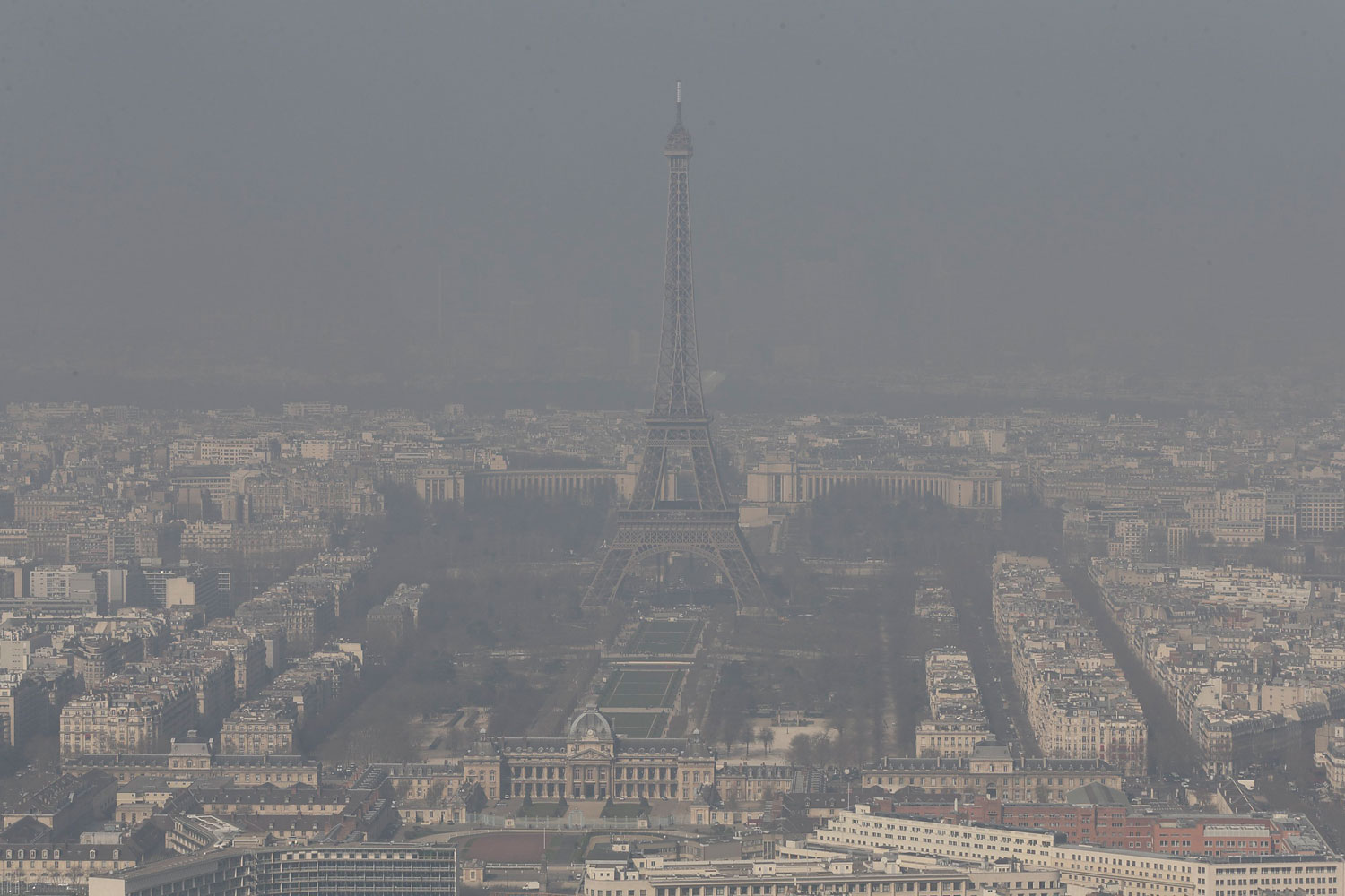 A general view shows the Eiffel tower and the Paris skyline through a small-particle haze March 13, 2014.