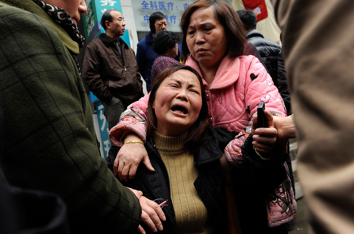 A woman cries after her parent was killed in a knifing incident in Changsha, Hunan province, China,  March 14, 2014.